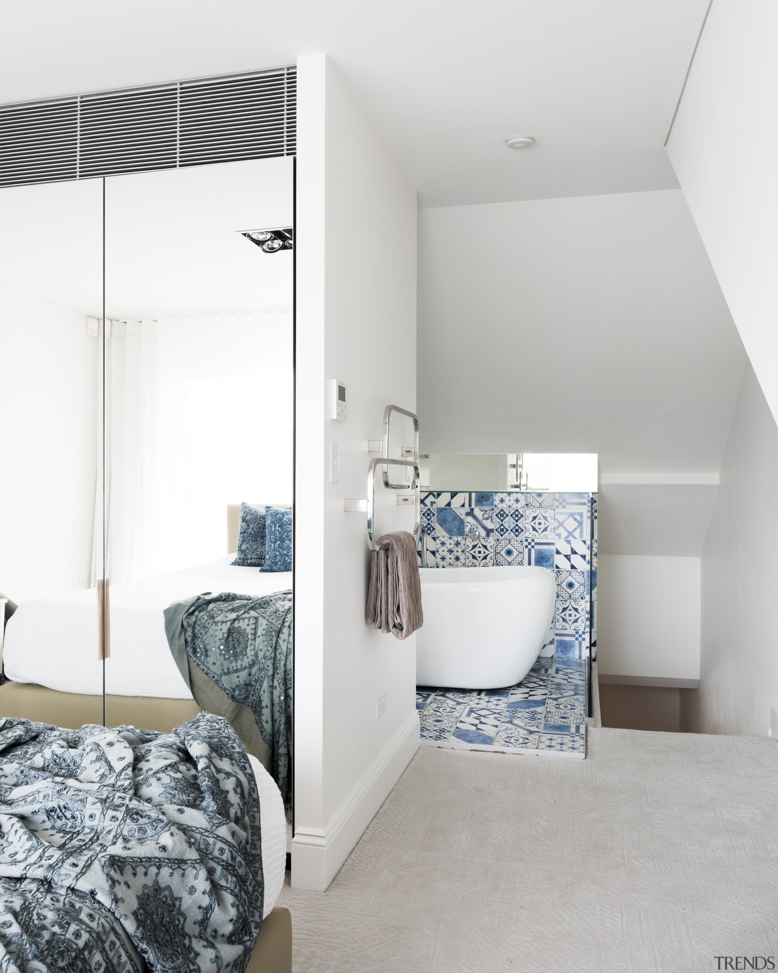 This master suite utilises previously unused space under architecture, bathroom, bed frame, bedroom, floor, home, house, interior design, product, room, tap, wall, white