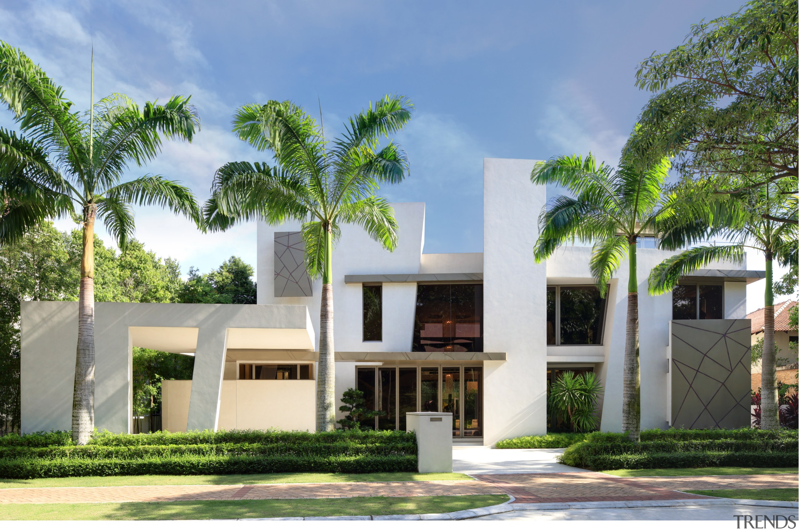 A picture of white stucco forms and dark architecture, arecales, building, condominium, elevation, estate, facade, home, house, official residence, palm tree, property, real estate, residential area, villa