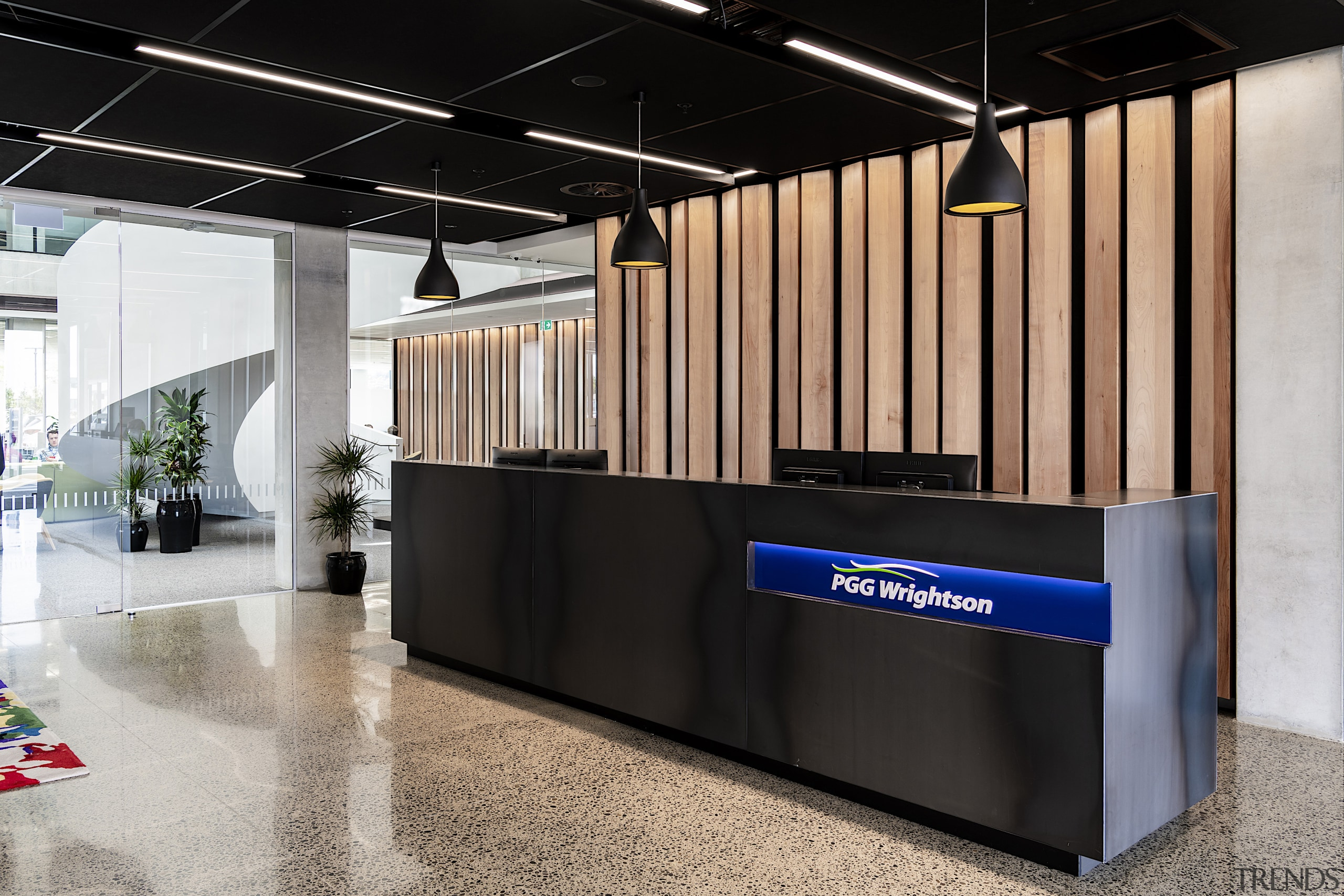 American beech panels behind the black reception desk