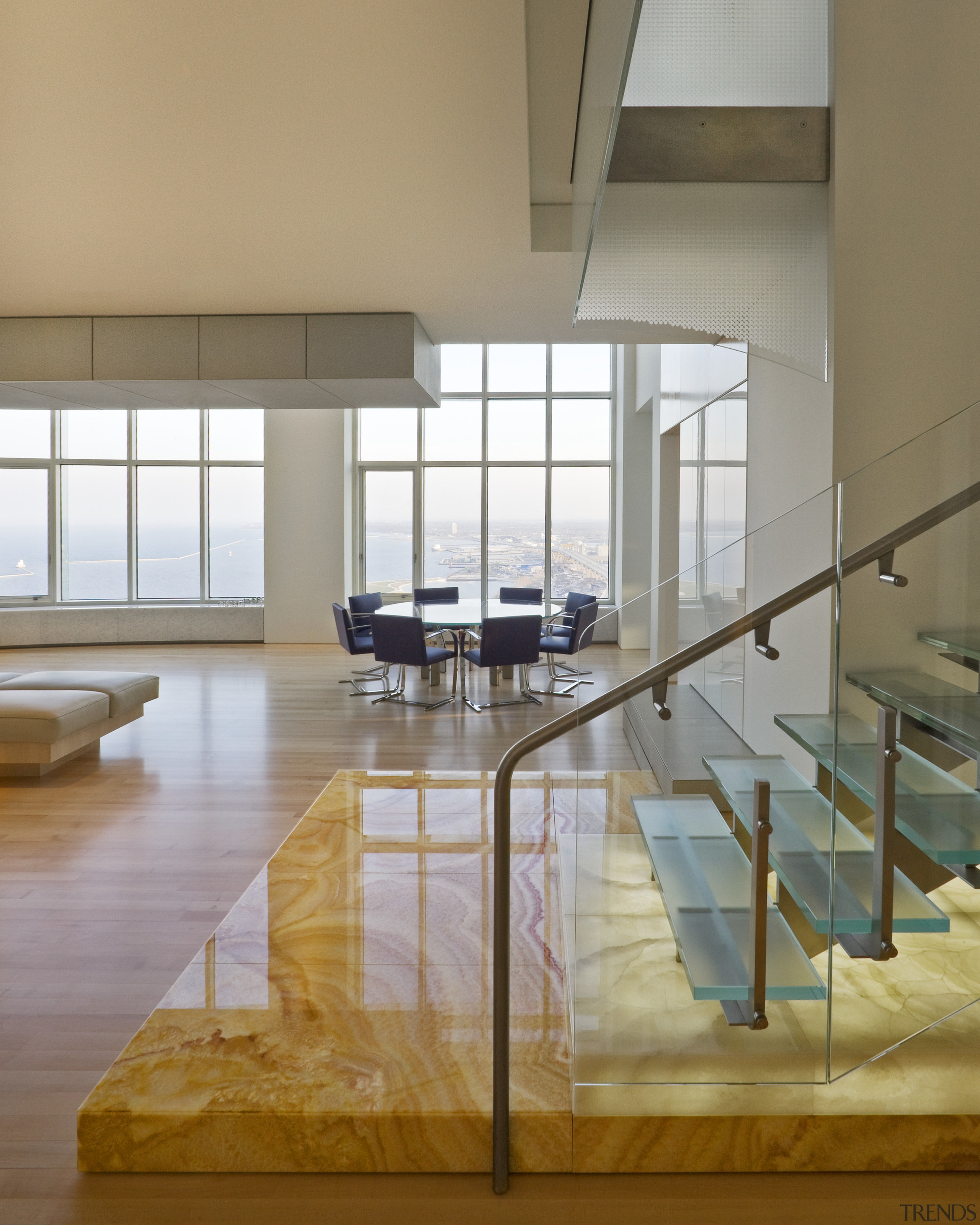 View of penthouse with white walls and a architecture, chair, daylighting, floor, flooring, furniture, glass, handrail, hardwood, interior design, loft, table, window, gray, brown