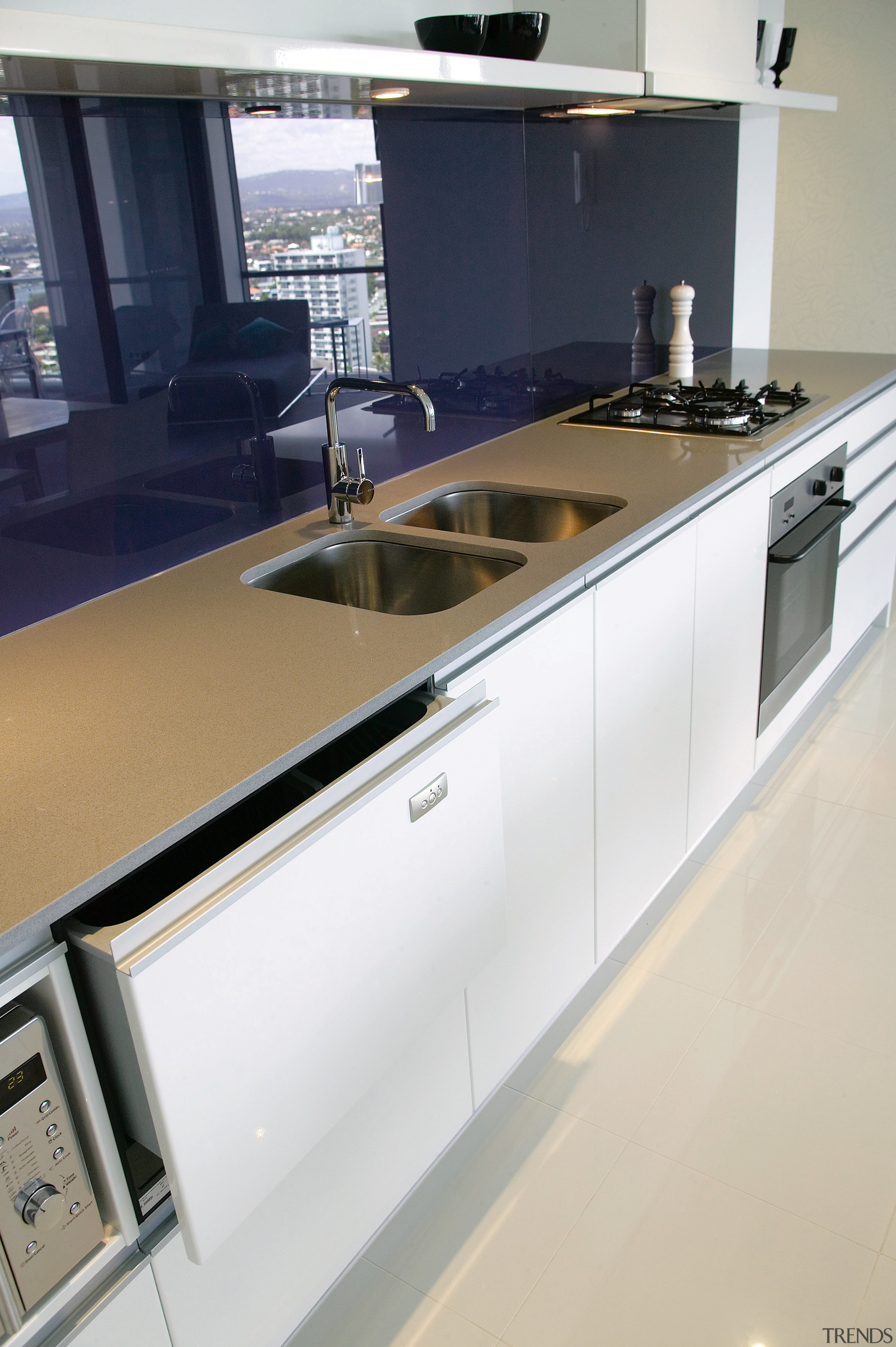 A view of this kitchen featuring the latest countertop, kitchen, gray, white