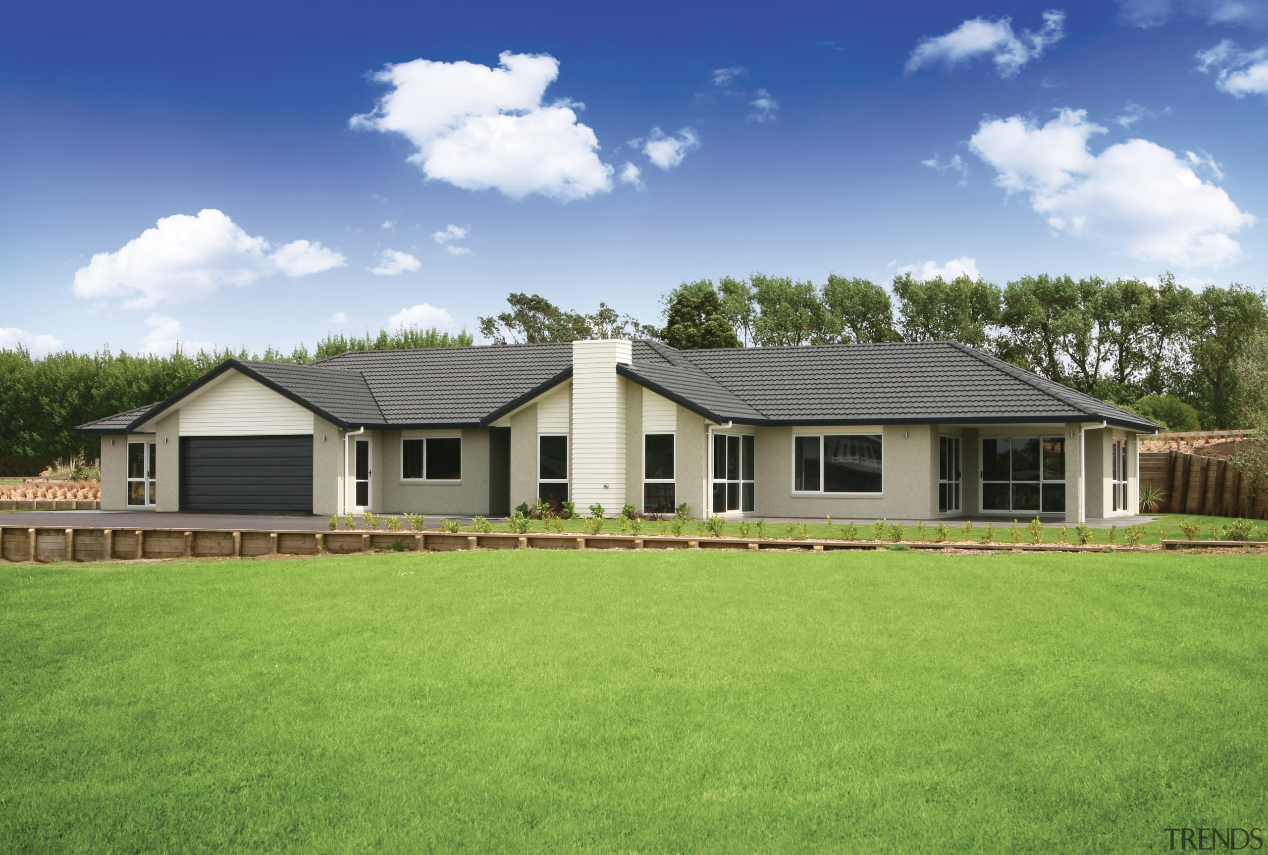Exterior view of this Platinum Homes show home backyard, cottage, elevation, estate, facade, farmhouse, grass, home, house, land lot, landscape, lawn, property, real estate, residential area, roof, shed, siding, sky, window, yard, green