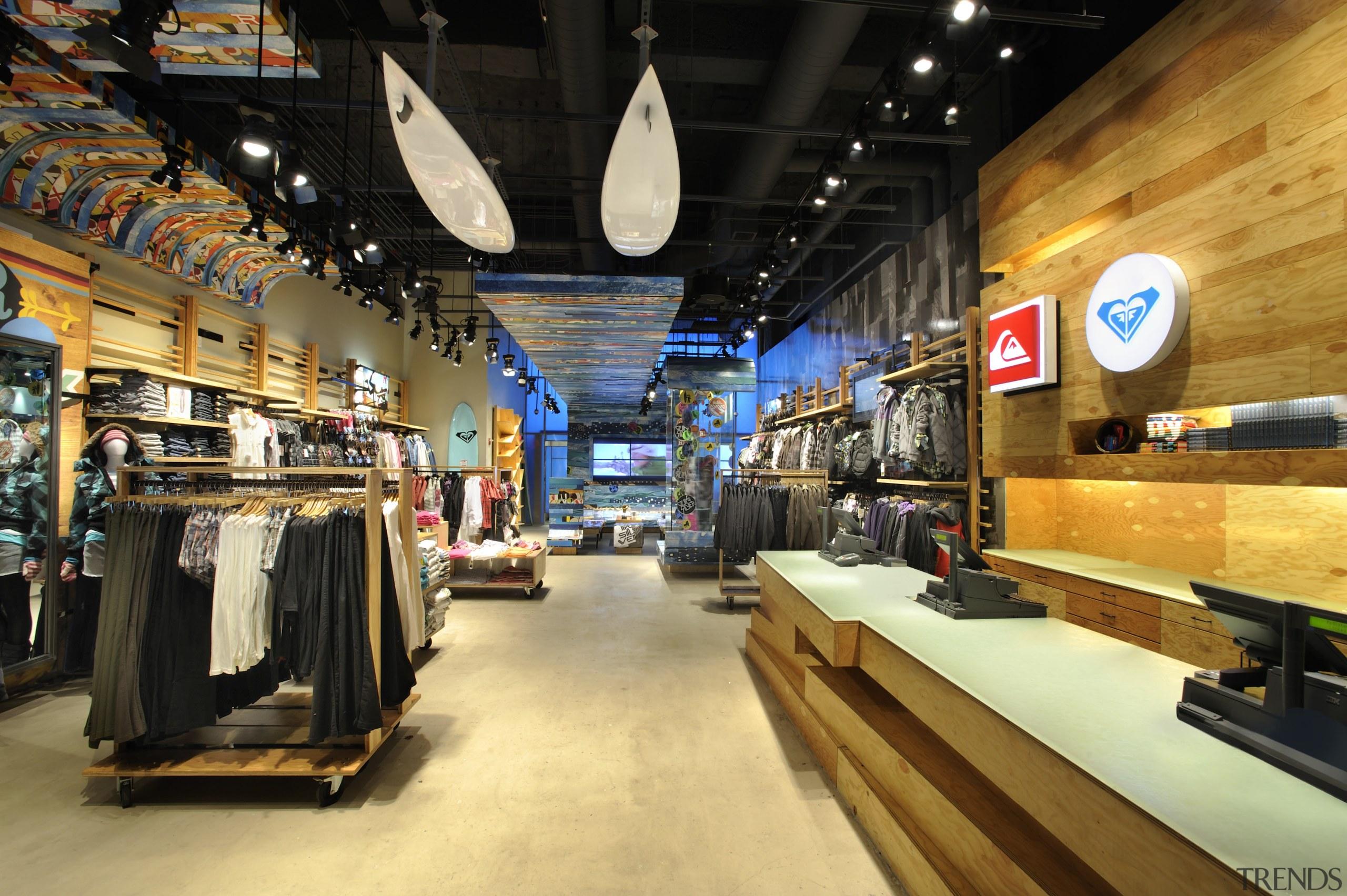 Interior view of the Quicksilver store in New retail, black, orange