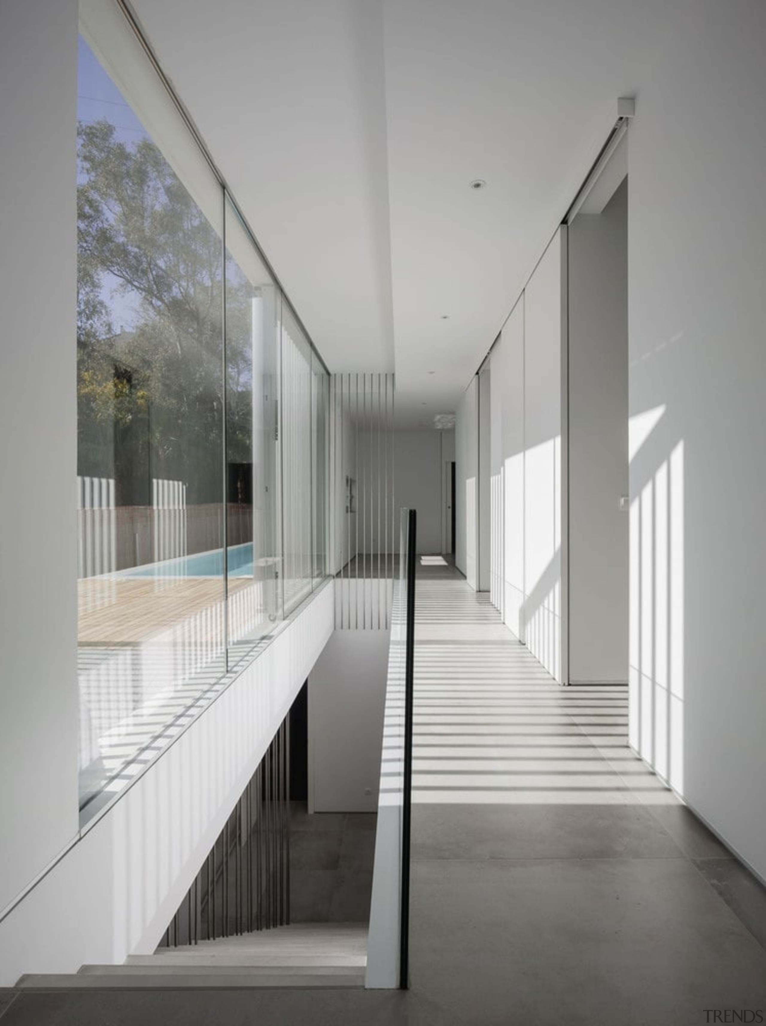 Floor to ceiling windows run the length of architecture, ceiling, daylighting, glass, handrail, house, interior design, gray
