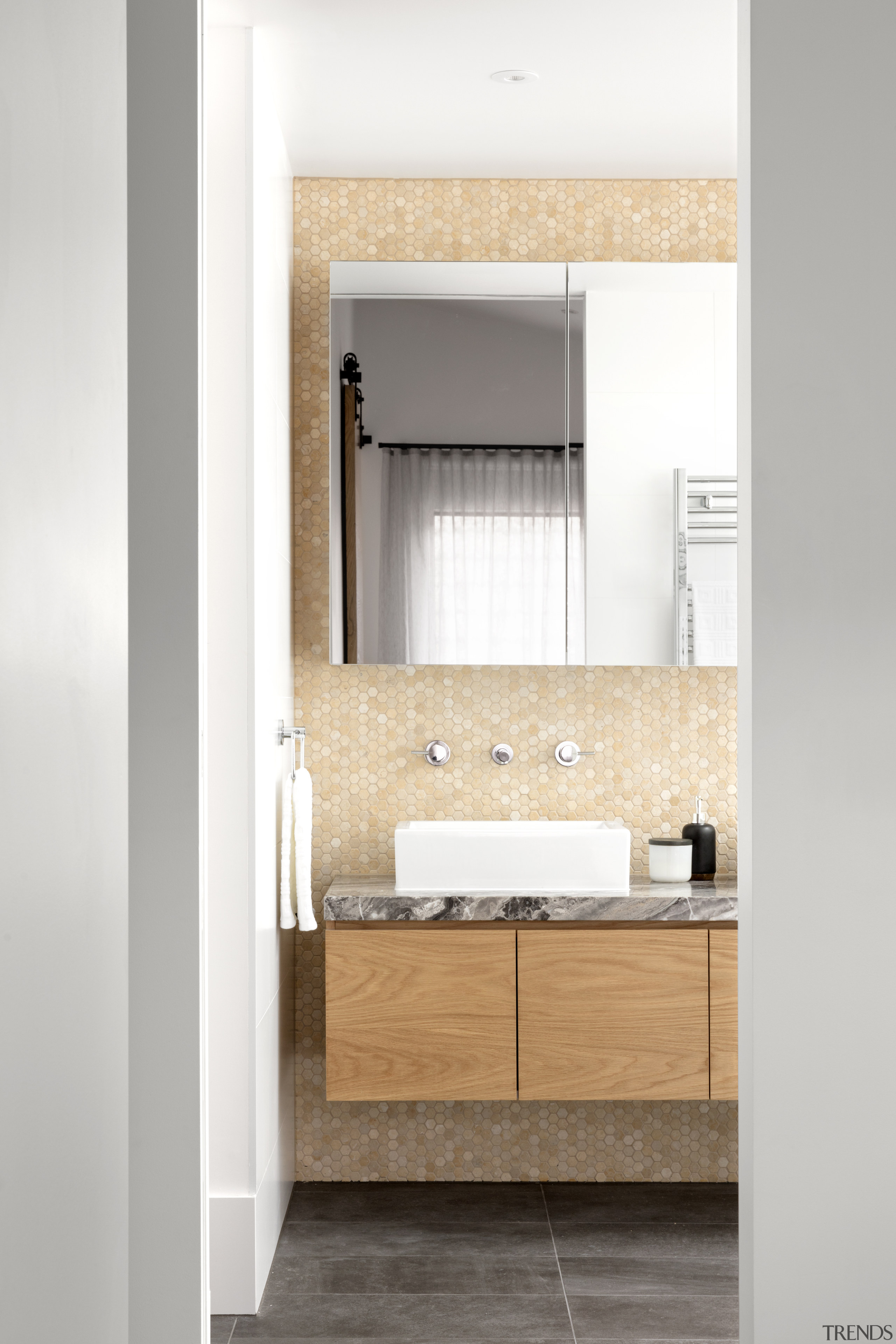 The honeycomb tile feature wall in the ensuite architecture, bathroom, floor, flooring, vanity unit, taps, Mcmaon & Nerlich