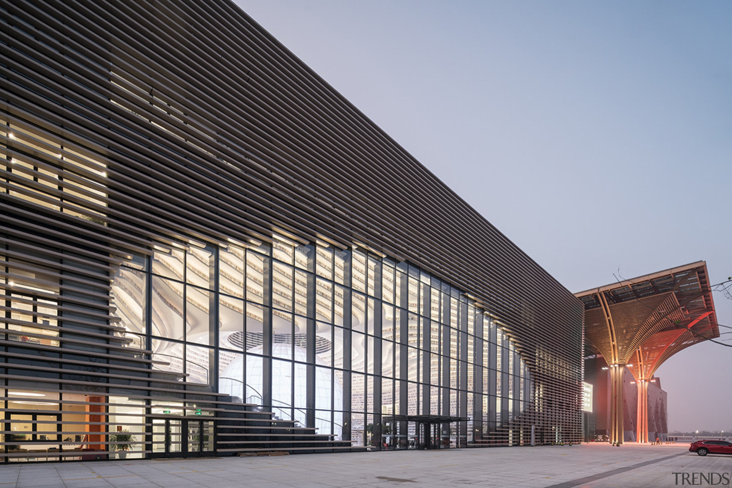 The Tianjin Binhai Library includes an eye-like aperture architecture, building, commercial building, convention center, corporate headquarters, daylighting, facade, headquarters, infrastructure, line, metropolis, metropolitan area, mixed use, sky, structure, gray, black
