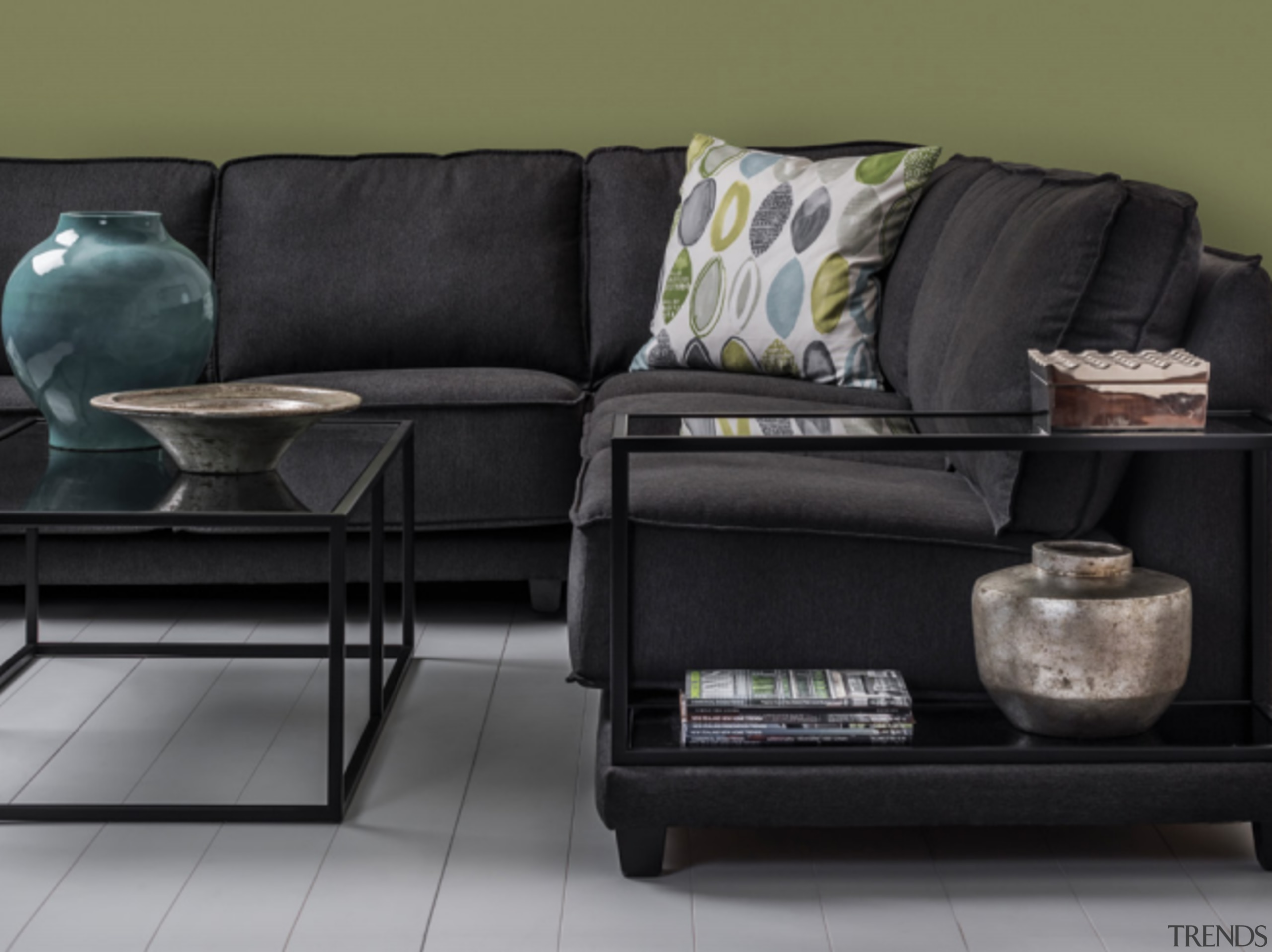 Avoid textured fabrics and bold patterns unless they armrest, black, chair, coffee table, couch, floor, flooring, furniture, interior design, laminate flooring, leather, living room, loveseat, rectangle, room, sofa bed, table, black
