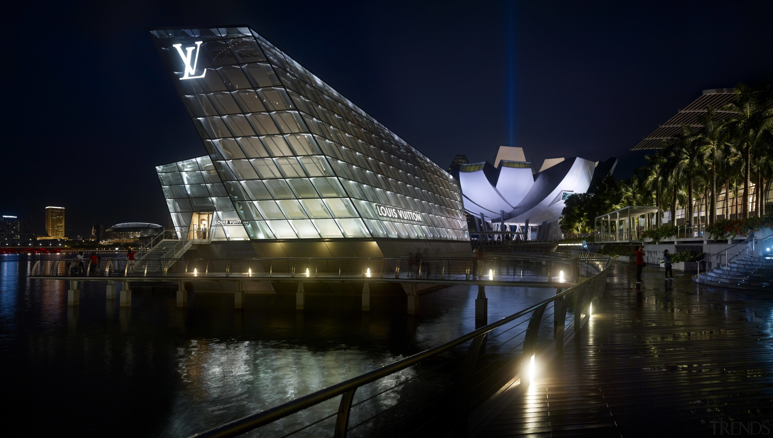Like the prow of a ship, the illuminated architecture, building, city, cityscape, landmark, light, lighting, metropolis, metropolitan area, night, reflection, sky, structure, tourist attraction, water, black