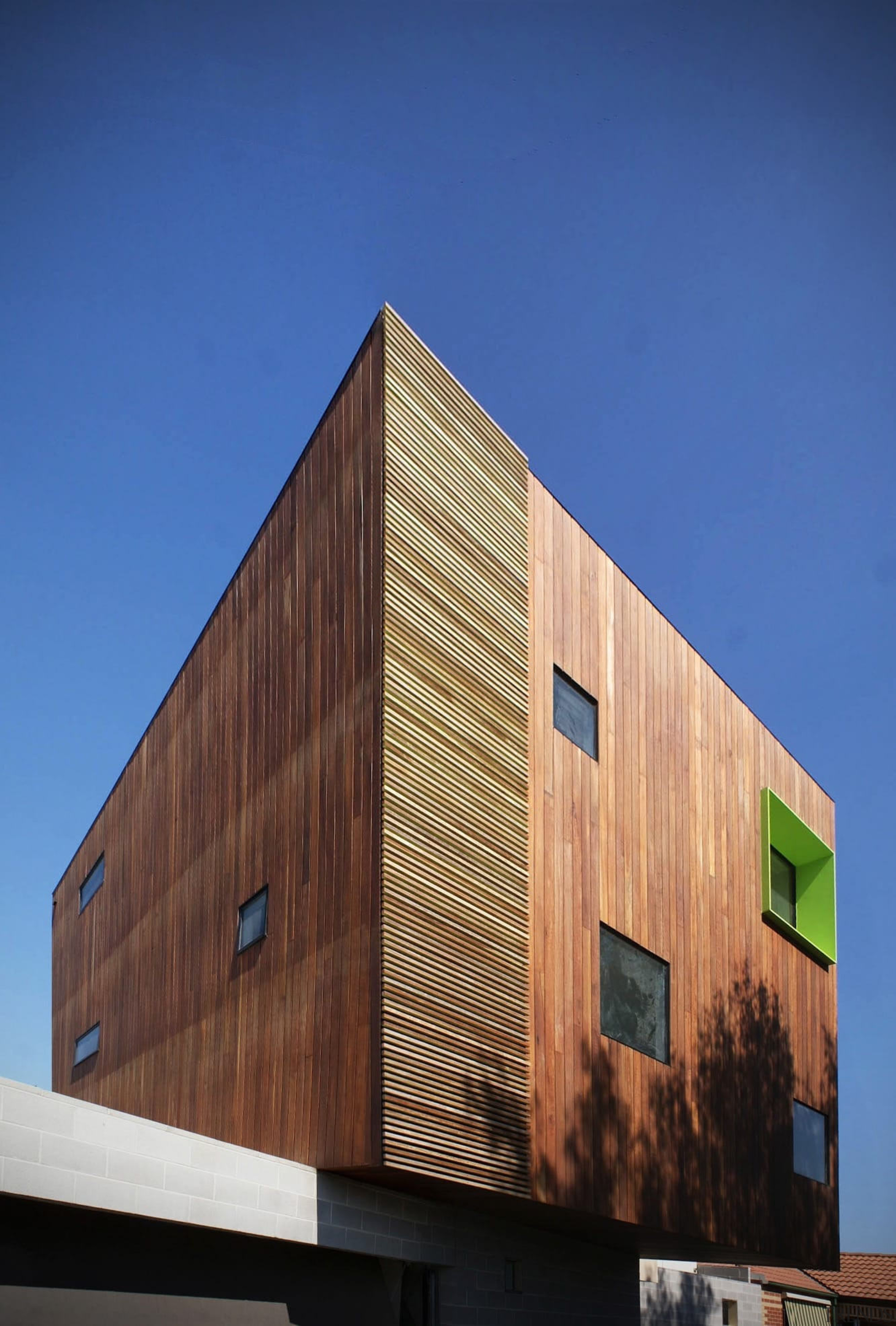 This green inset breaks up the wood - architecture, building, daylighting, facade, house, siding, sky, wall, wood, blue