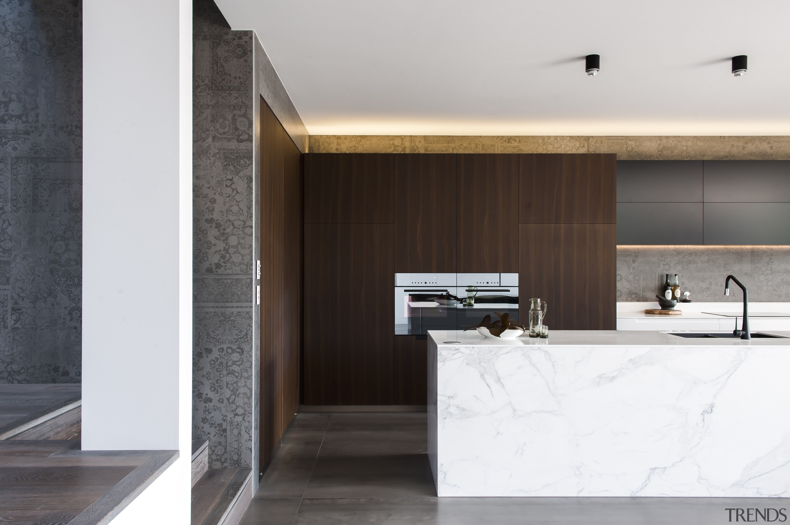 There are three ways into this kitchen, from architecture, countertop, floor, interior design, product design, white, black
