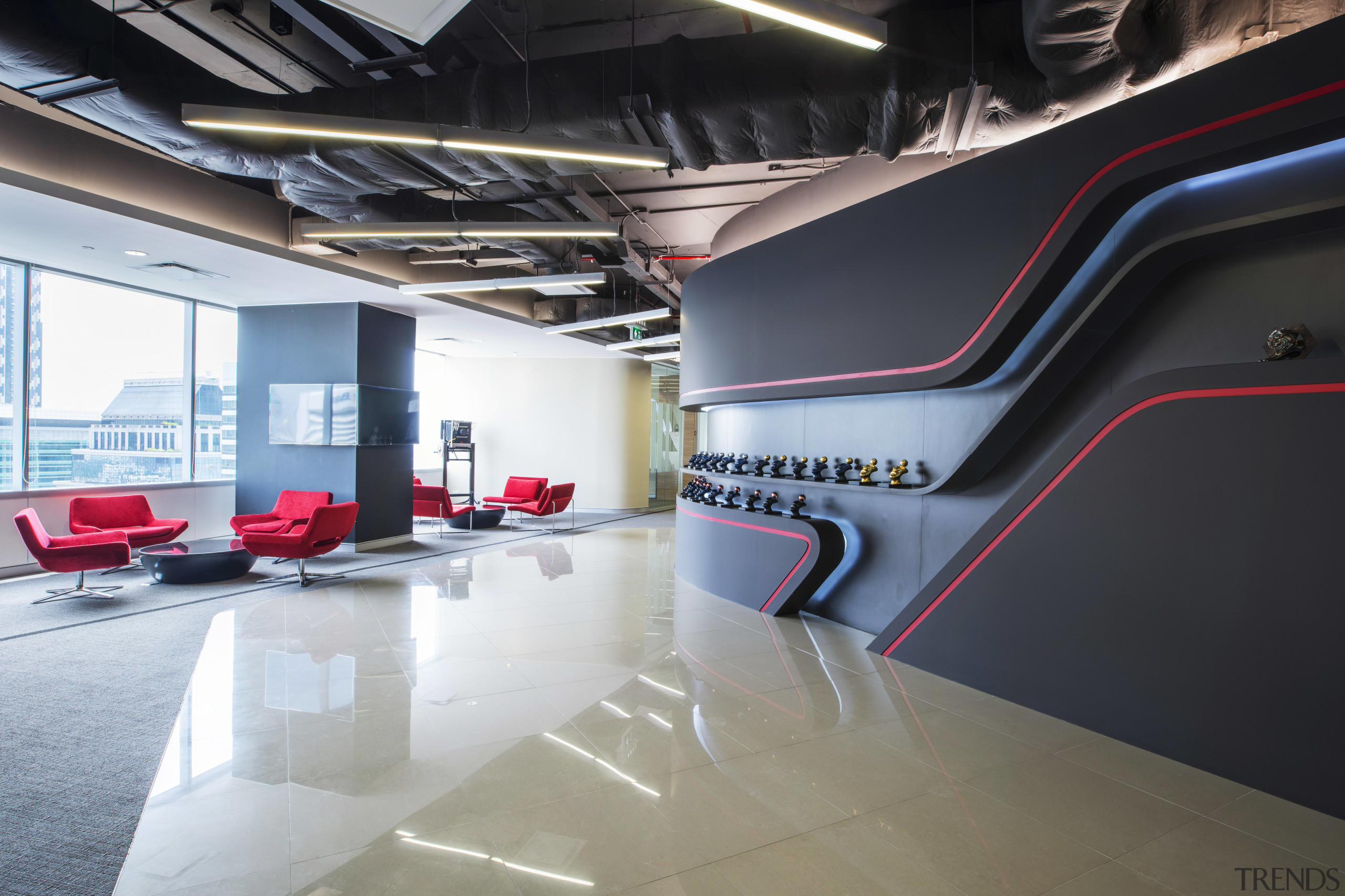 This curved wall in the reception area of architecture, automotive design, car, floor, flooring, interior design, product design, structure, black, white