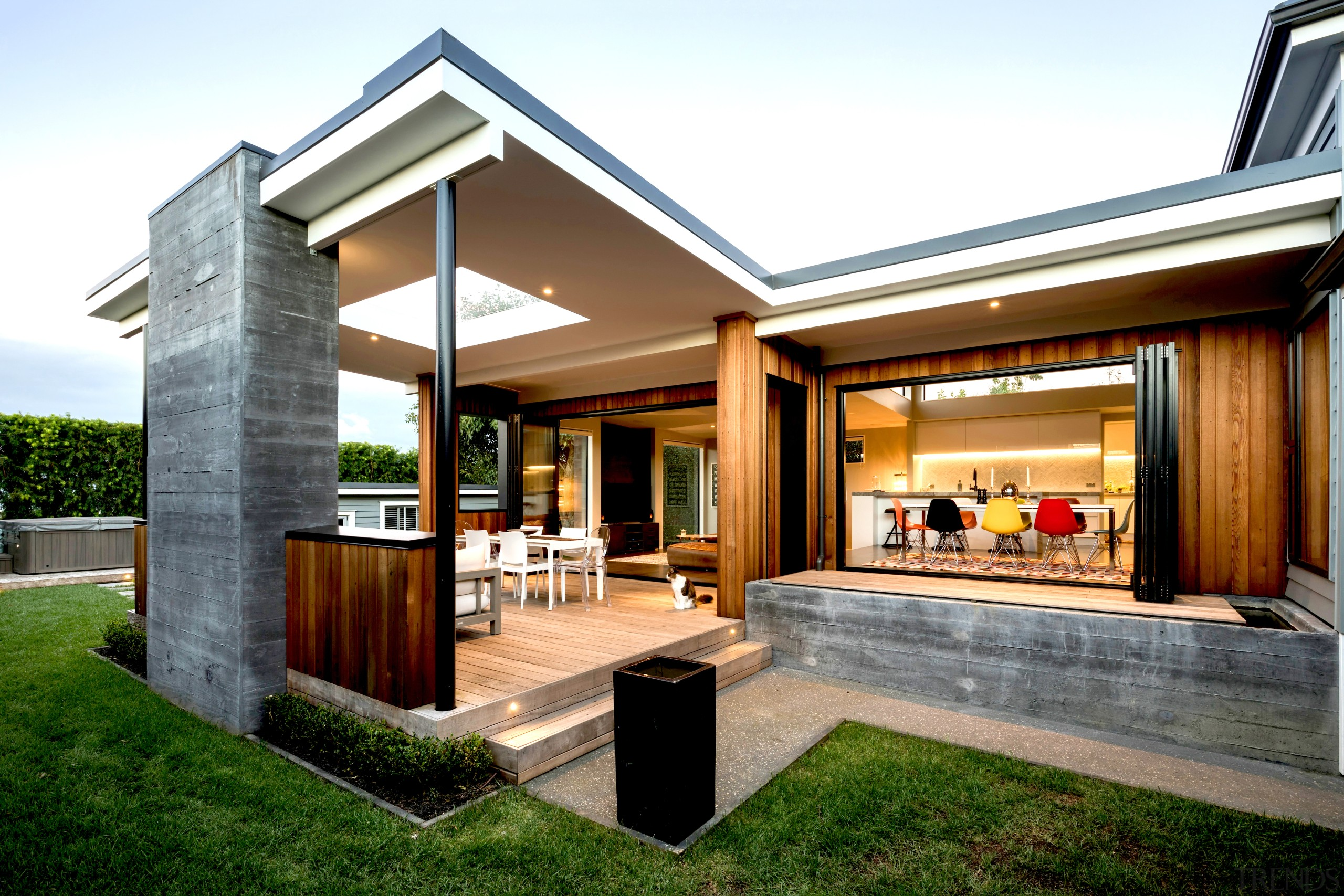 For this renovation, materials were chosen to contrast architecture, backyard, building, courtyard, design, estate, facade, grass, home, house, interior design, patio, property, real estate, residential area, roof, siding, white