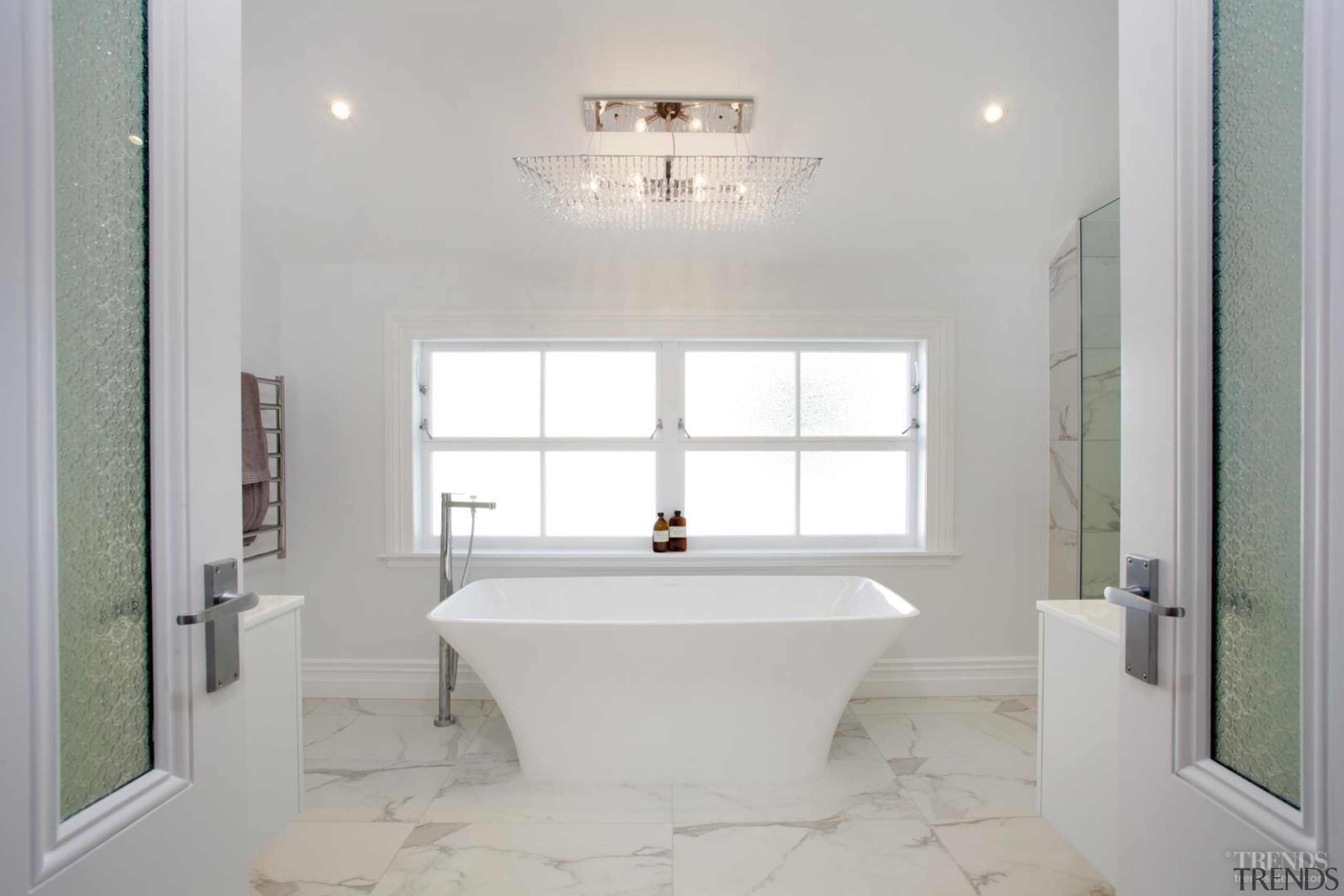 The master bathroom to the rear of this bathroom, ceiling, daylighting, estate, floor, home, interior design, plumbing fixture, property, real estate, room, sink, tile, window, gray