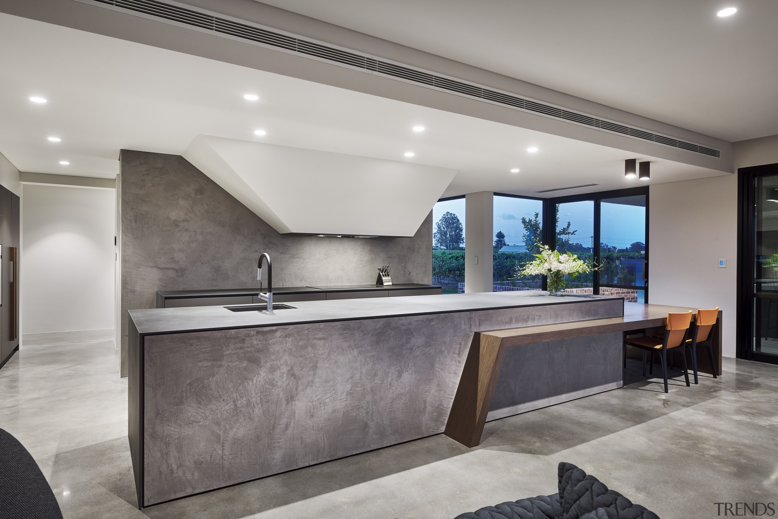 The kitchen's strong, sculptural nature extends to the