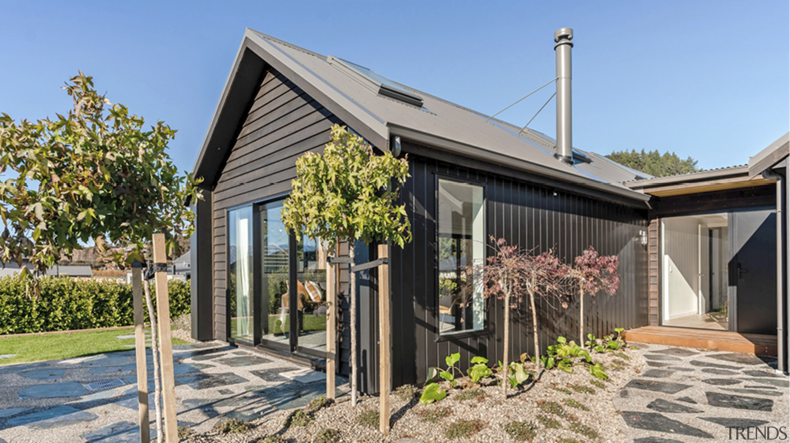 A character paved approach leads to the home's