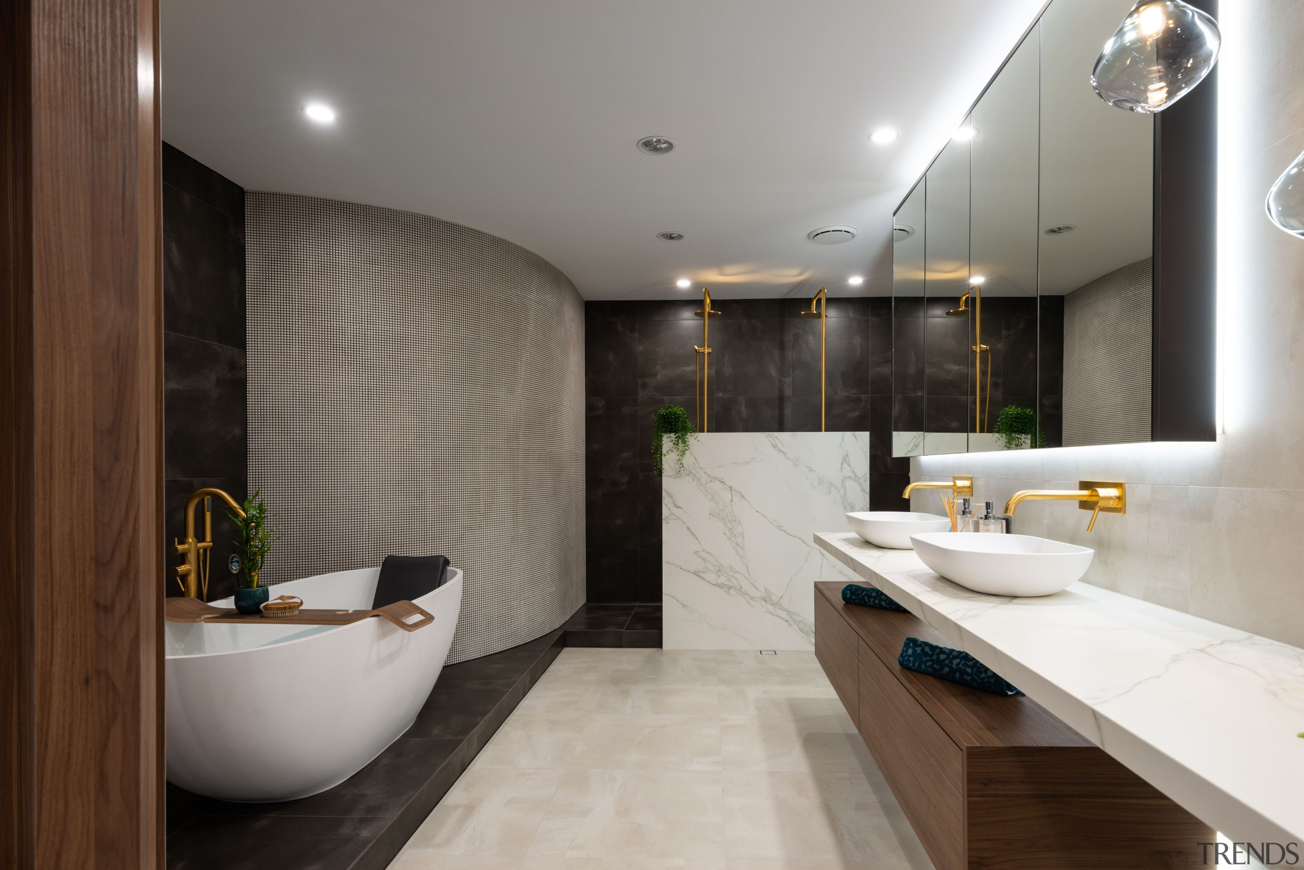 While designed along contemporary, pared back and sculptural architecture, bathroom, building, ceiling, countertop, floor, flooring, furniture, home, house, interior design, material property, plumbing fixture, property, real estate, room, sink, tap, tile, gray, black