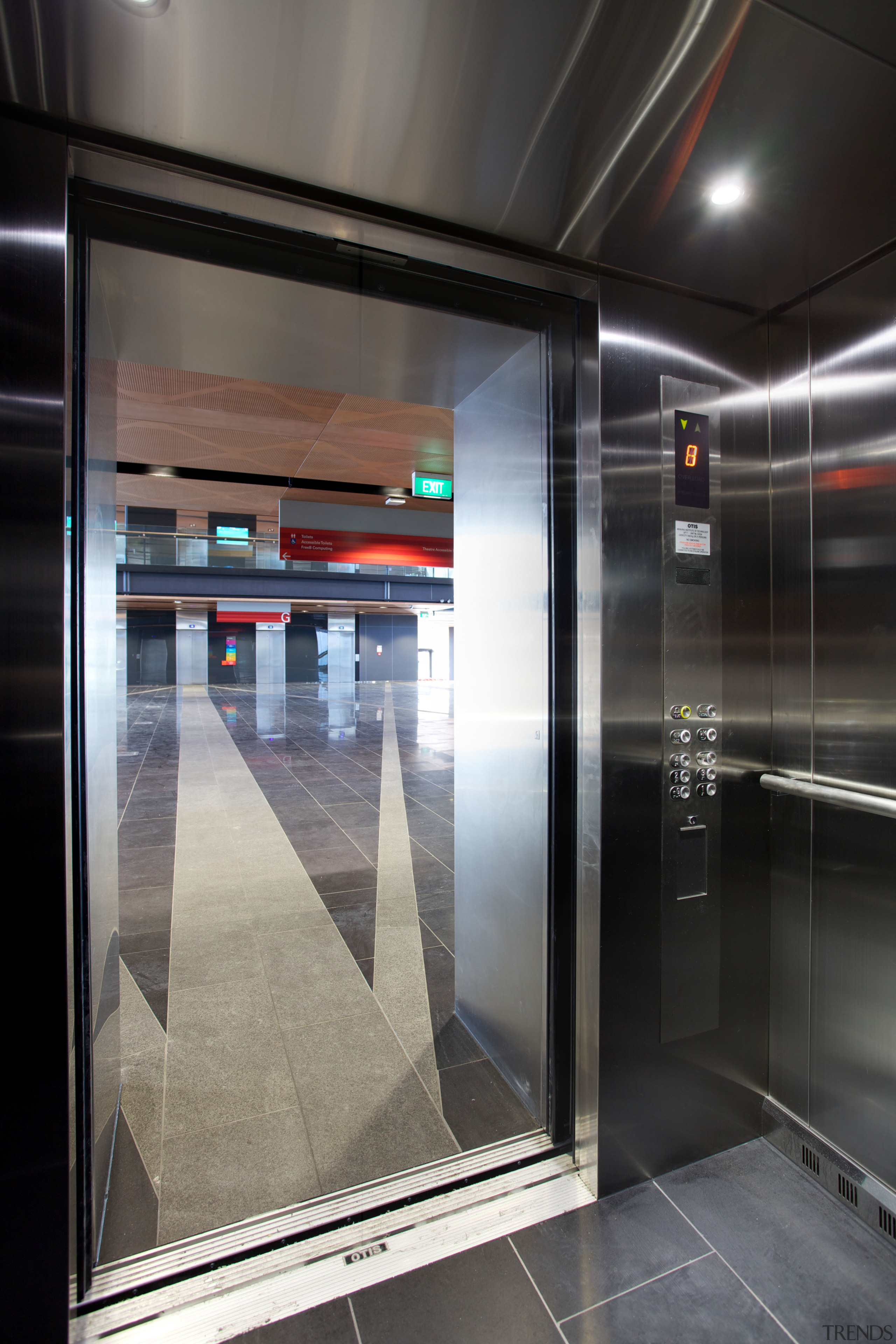 The Otis Gen2 Premier2 elevators on the MIT elevator, floor, glass, interior design, black, gray