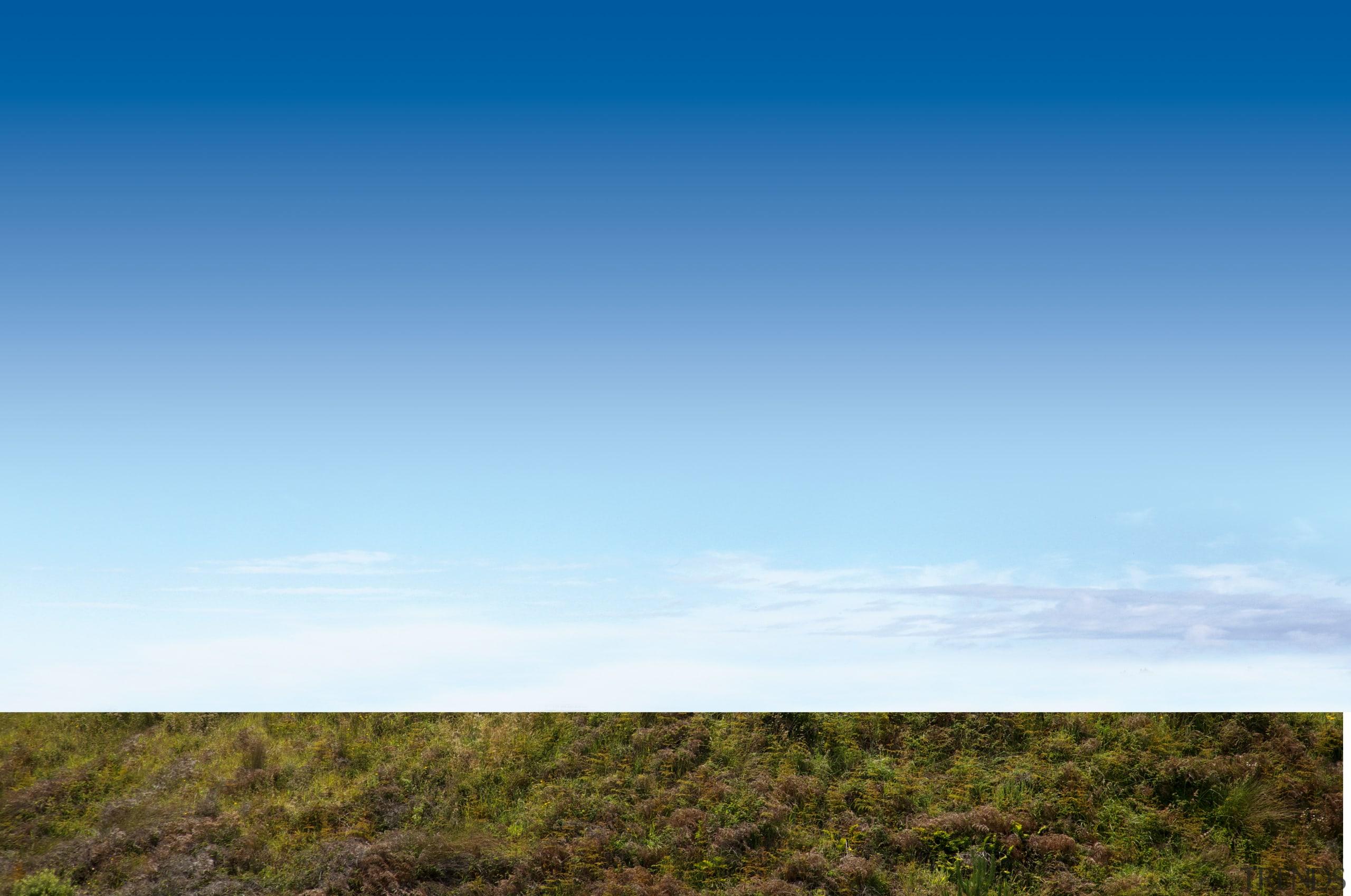 This new Lockwood beach house was custom designed atmosphere, cloud, daytime, ecoregion, ecosystem, field, grass, grassland, highland, hill, horizon, meadow, plain, prairie, sky, steppe, tree, teal