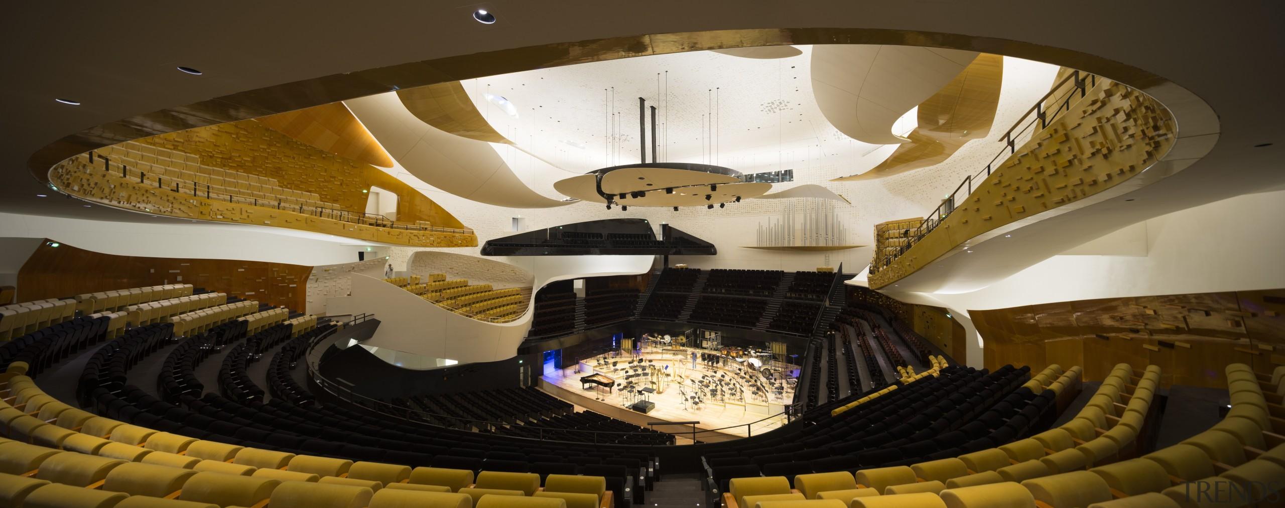 The auditorium at the Philharmonie de Paris was architecture, auditorium, ceiling, light, lighting, performing arts center, theatre, tourist attraction, yellow, brown