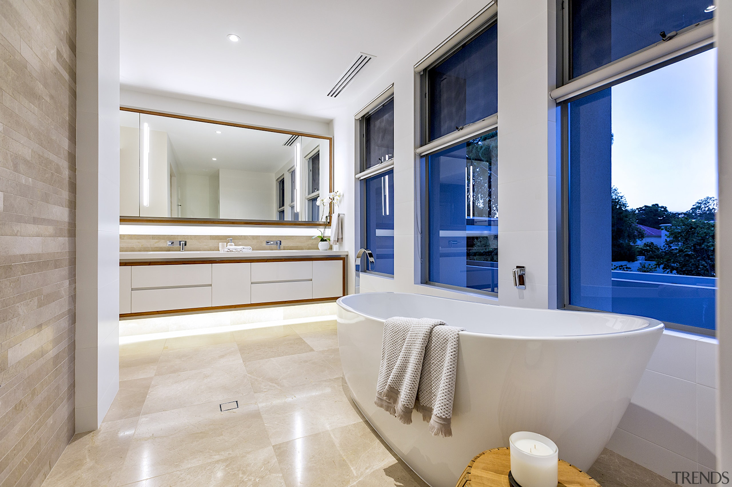 Freestanding tub is positioned by windows to let architecture, bathroom, bathtub, building, cabinetry, ceiling, estate, floor, furniture, home, house, interior design, property, real estate, room, suite, tap, gray