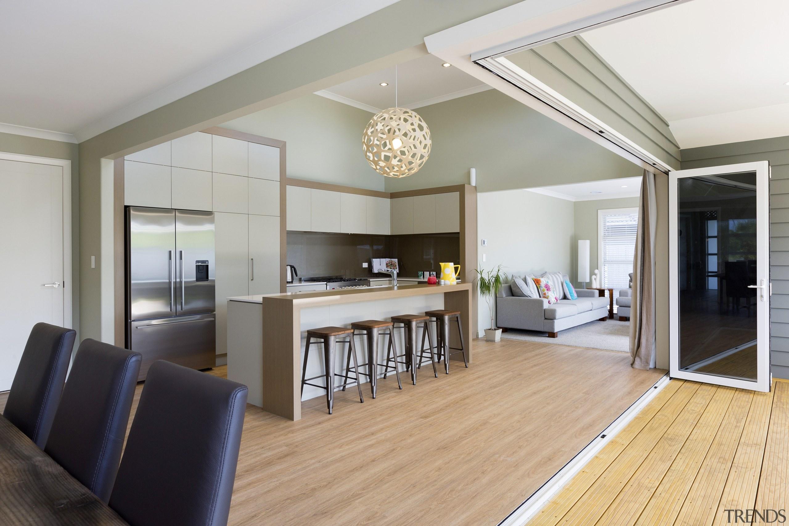 Recessed runners enhance the indoor-outdoor flow in this floor, interior design, living room, real estate, room, gray