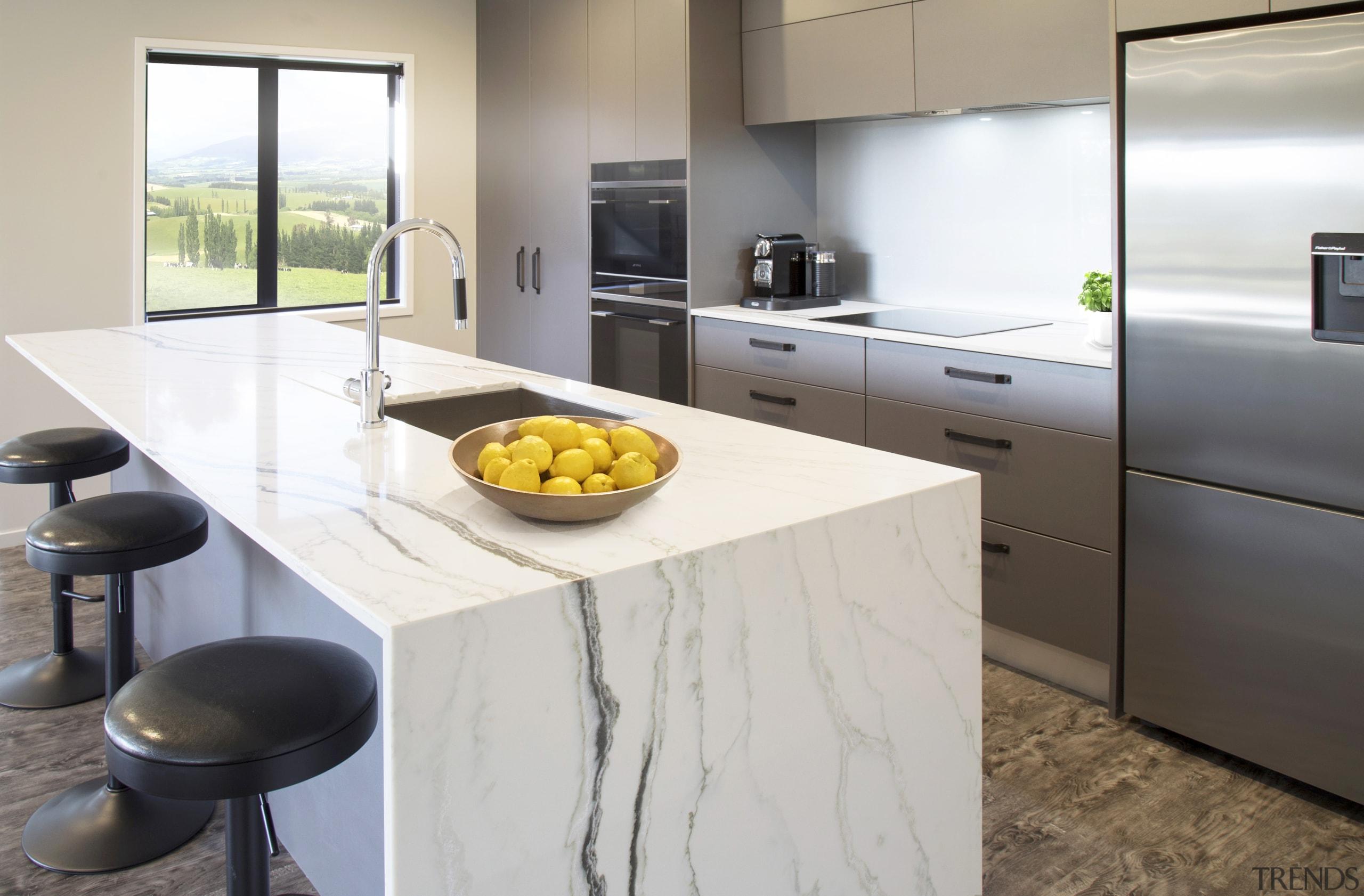This eye-catching kitchen, by designer Kim Primrose, features countertop, floor, interior design, kitchen, gray