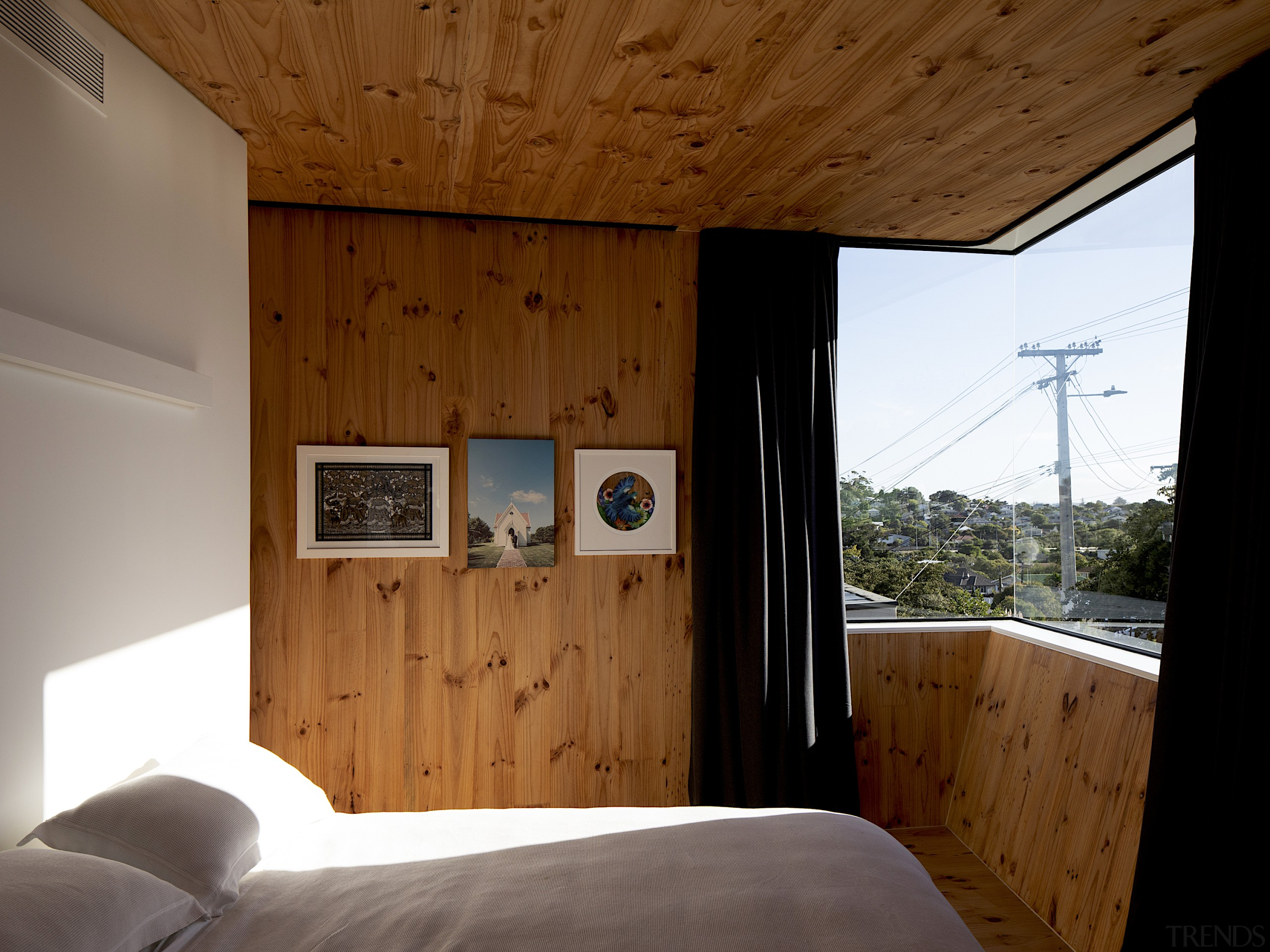 High ceilings and sloping walls of exposed timber brown