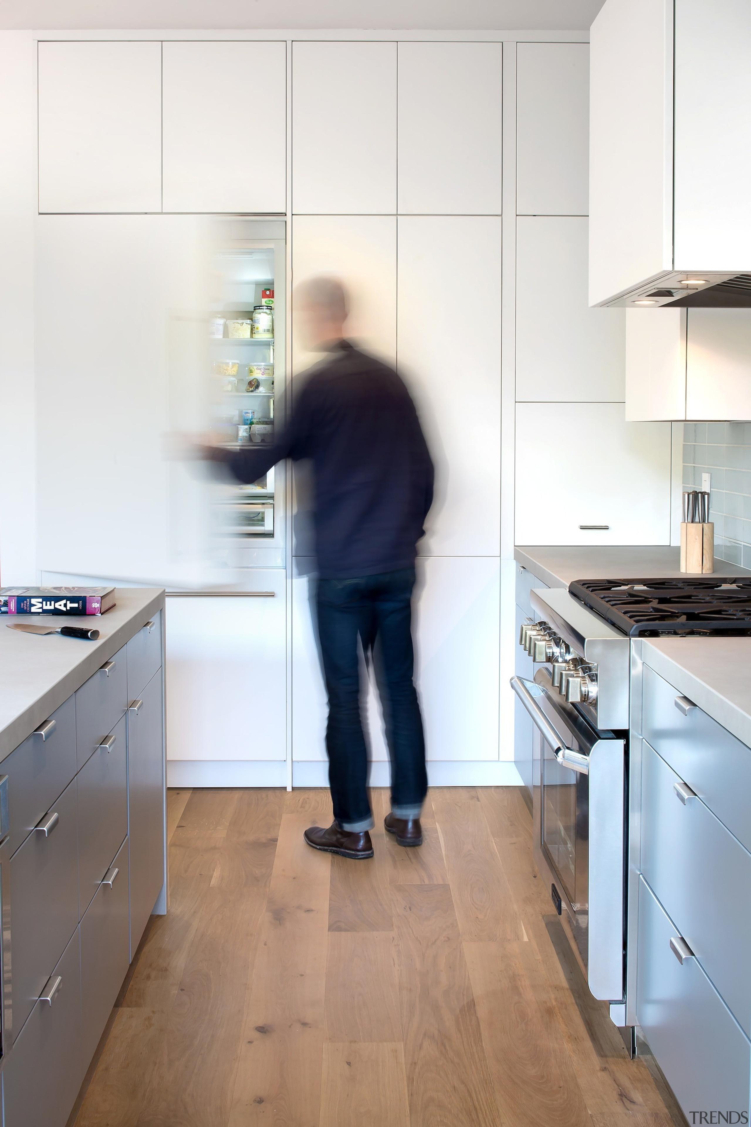 A large kitchen features plenty of storage - countertop, floor, flooring, furniture, home appliance, house, interior design, kitchen, room, wood, white