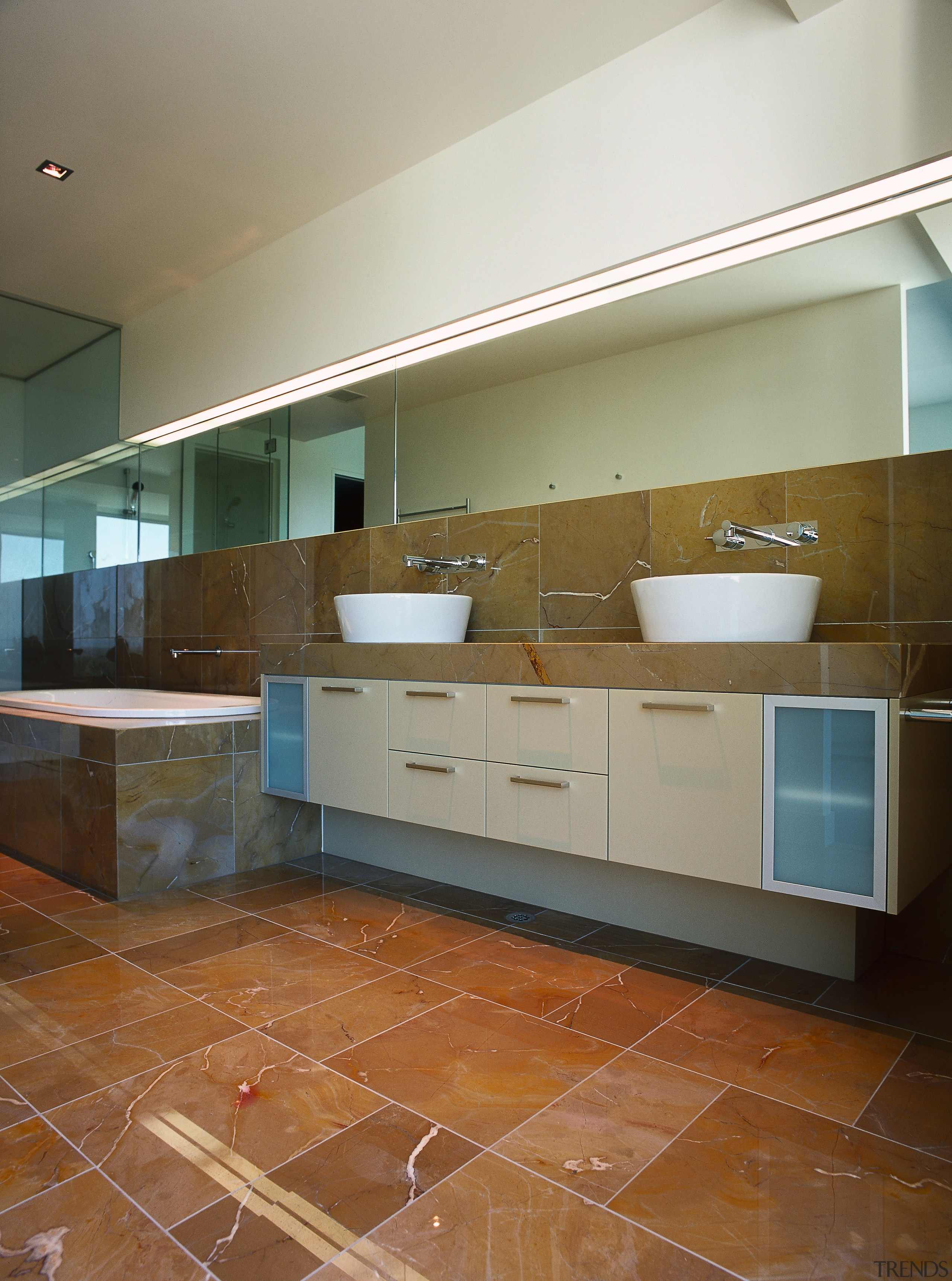 bathrooms features marble tiling on the floor and apartment, architecture, bathroom, cabinetry, countertop, daylighting, floor, flooring, hardwood, home, house, interior design, kitchen, laminate flooring, property, real estate, room, sink, tile, wall, wood, wood flooring, brown, gray