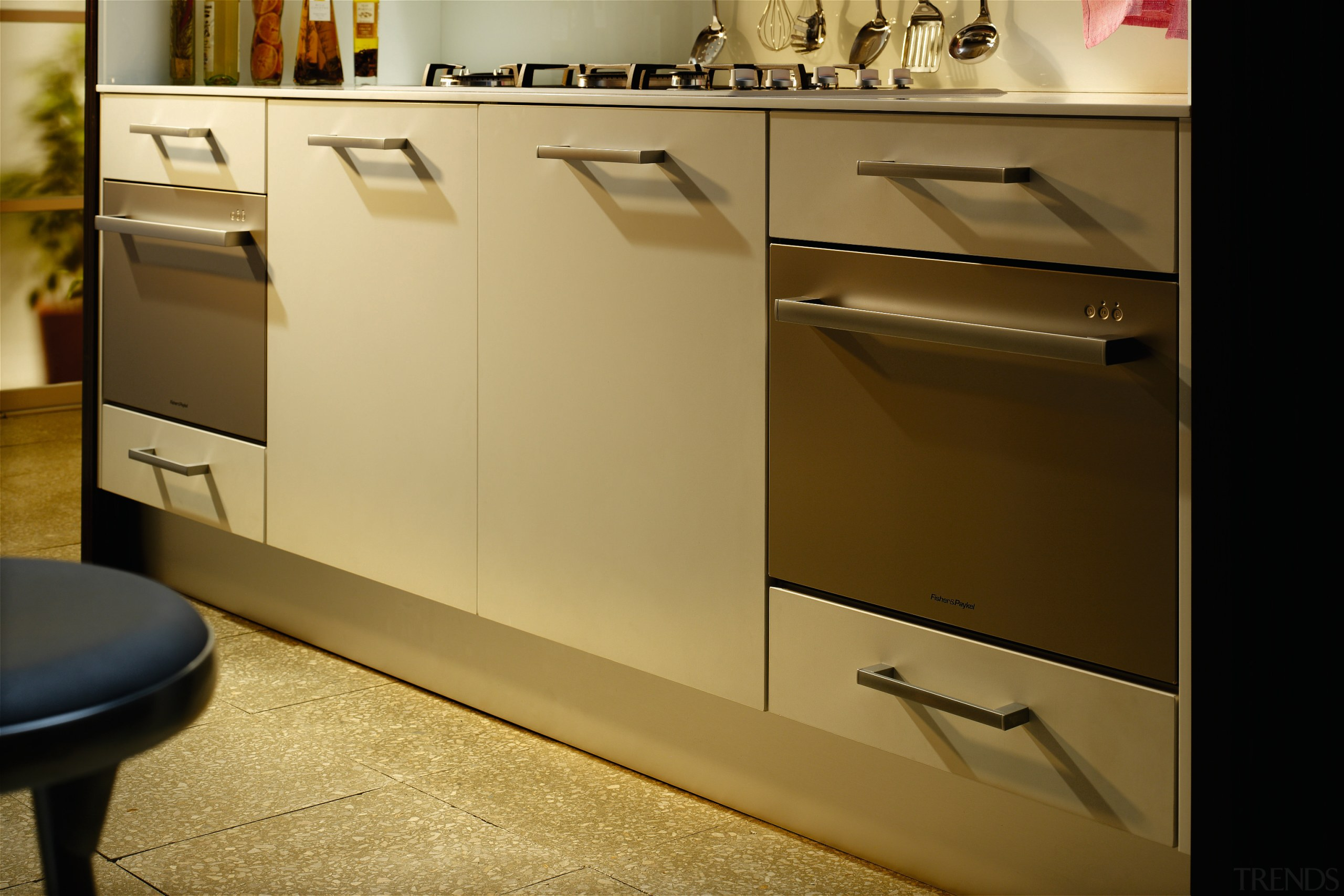 Examples of the new Fisher & Paykel technology cabinetry, chest of drawers, countertop, drawer, floor, flooring, furniture, home appliance, kitchen, product, product design, sideboard, brown, orange