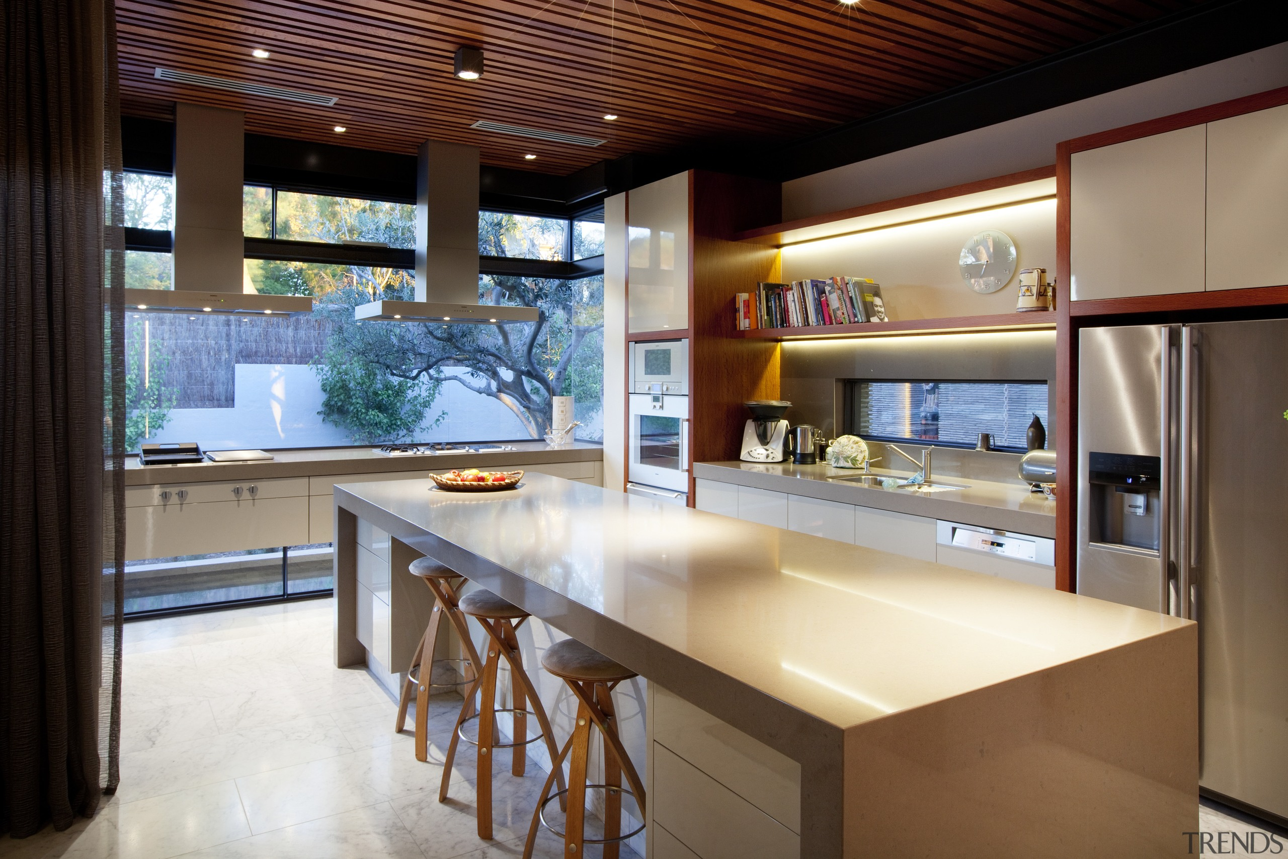 Twin rangehoods and a cantilevered cabinet are key countertop, interior design, kitchen, real estate, black
