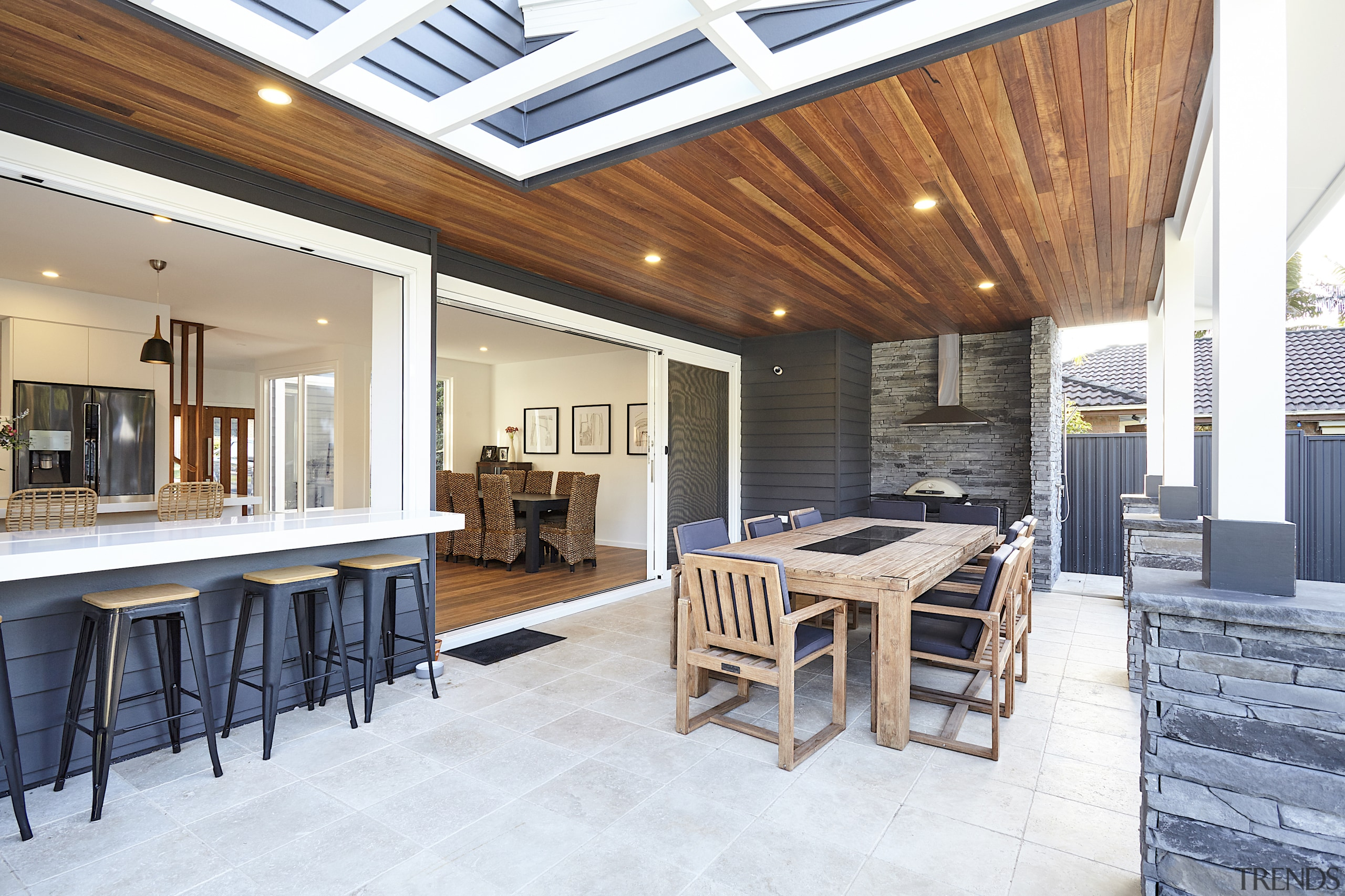 The covered outdoor rooms morphs into the open
