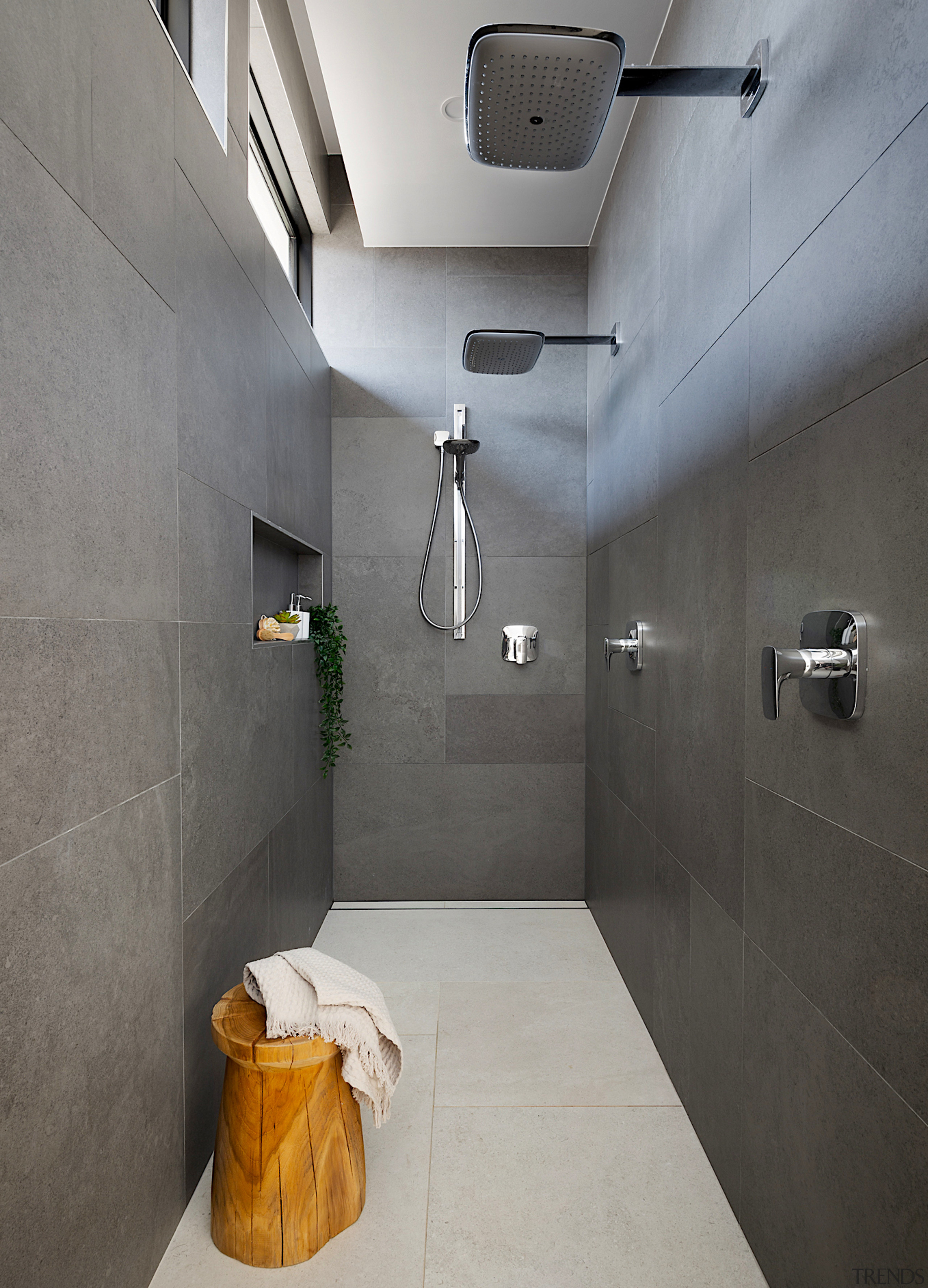 The shower is tucked out of sight behind architecture, bathroom, building, ceiling, daylighting, floor, interior design, plumbing fixture, property, room, tile, wall, gray