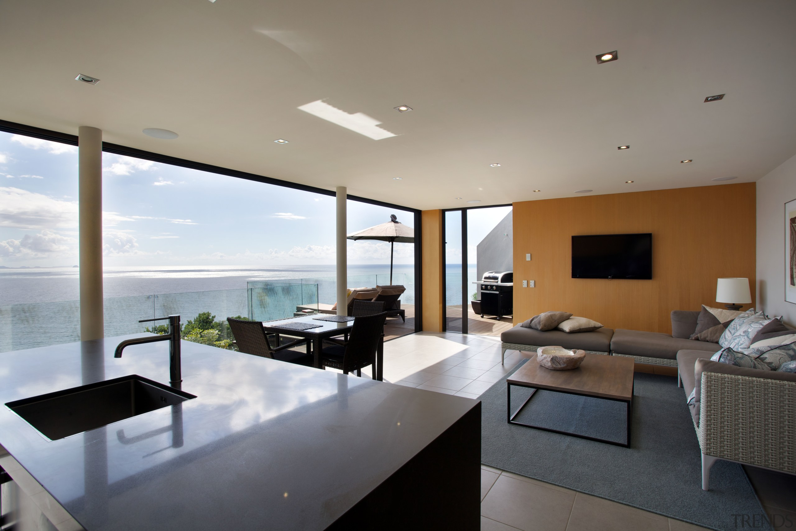 Left: The simplicity of the design is a apartment, architecture, house, interior design, living room, penthouse apartment, property, real estate, window, gray