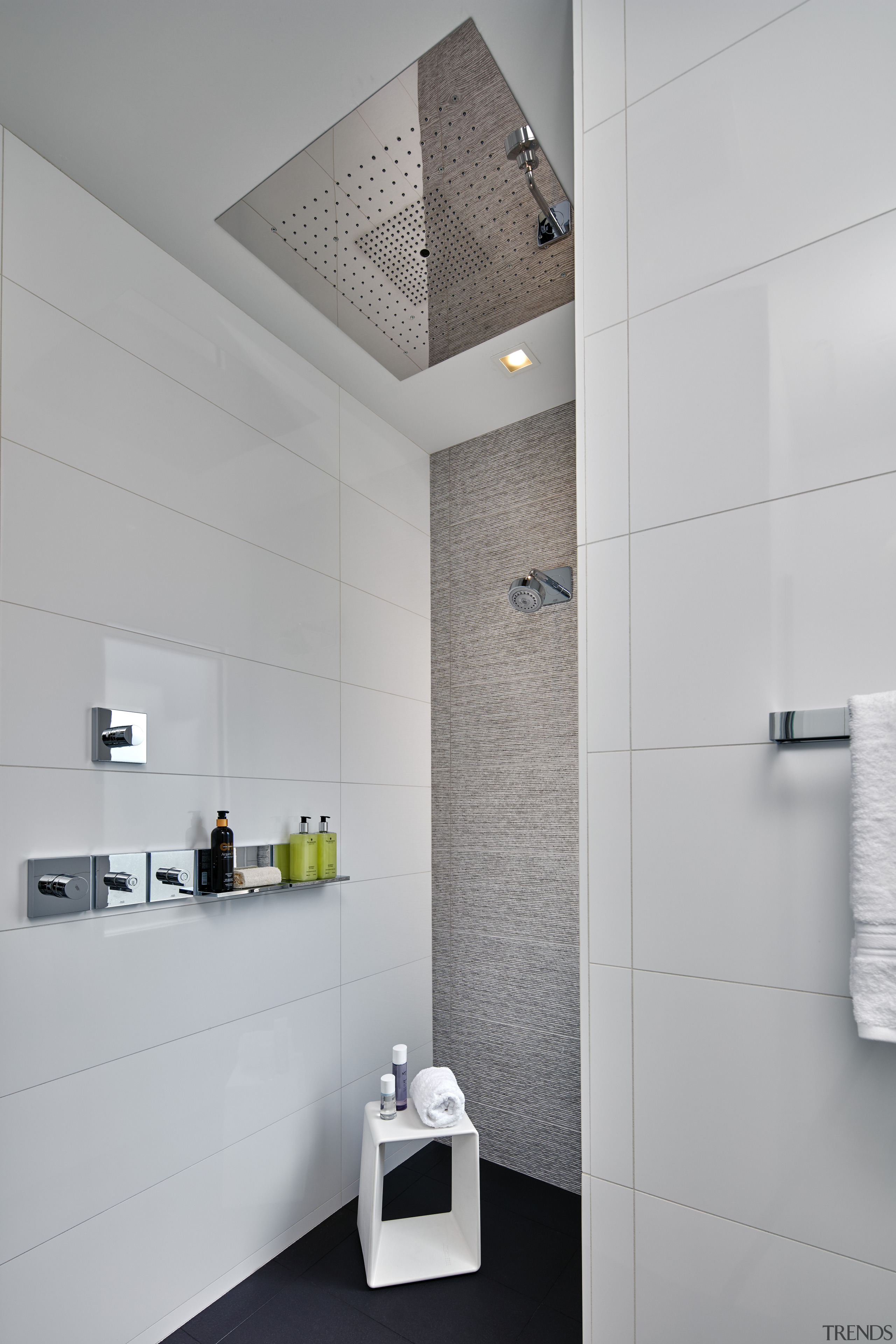 For this master bathroom design, a gently sloping architecture, bathroom, bathroom accessory, bathroom cabinet, daylighting, floor, interior design, plumbing fixture, room, sink, tap, tile, wall, gray