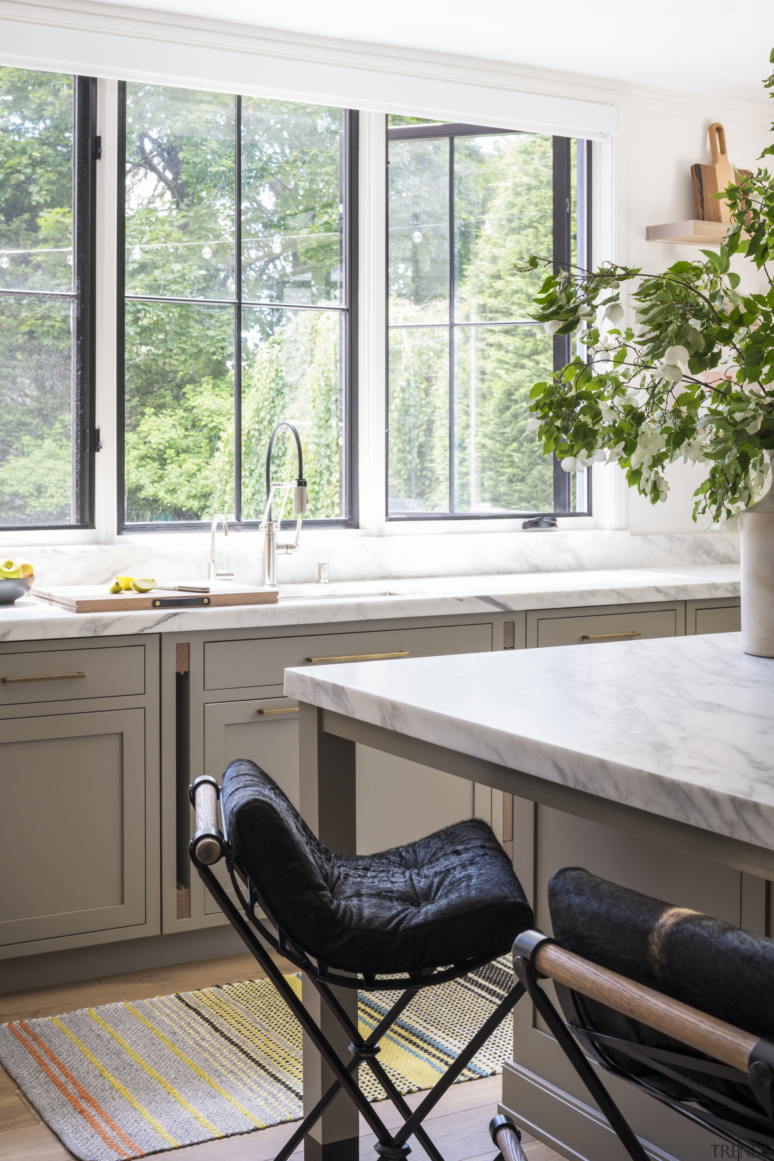​​​​​​​Marble countertops add to this Studio Dearborn kitchen's