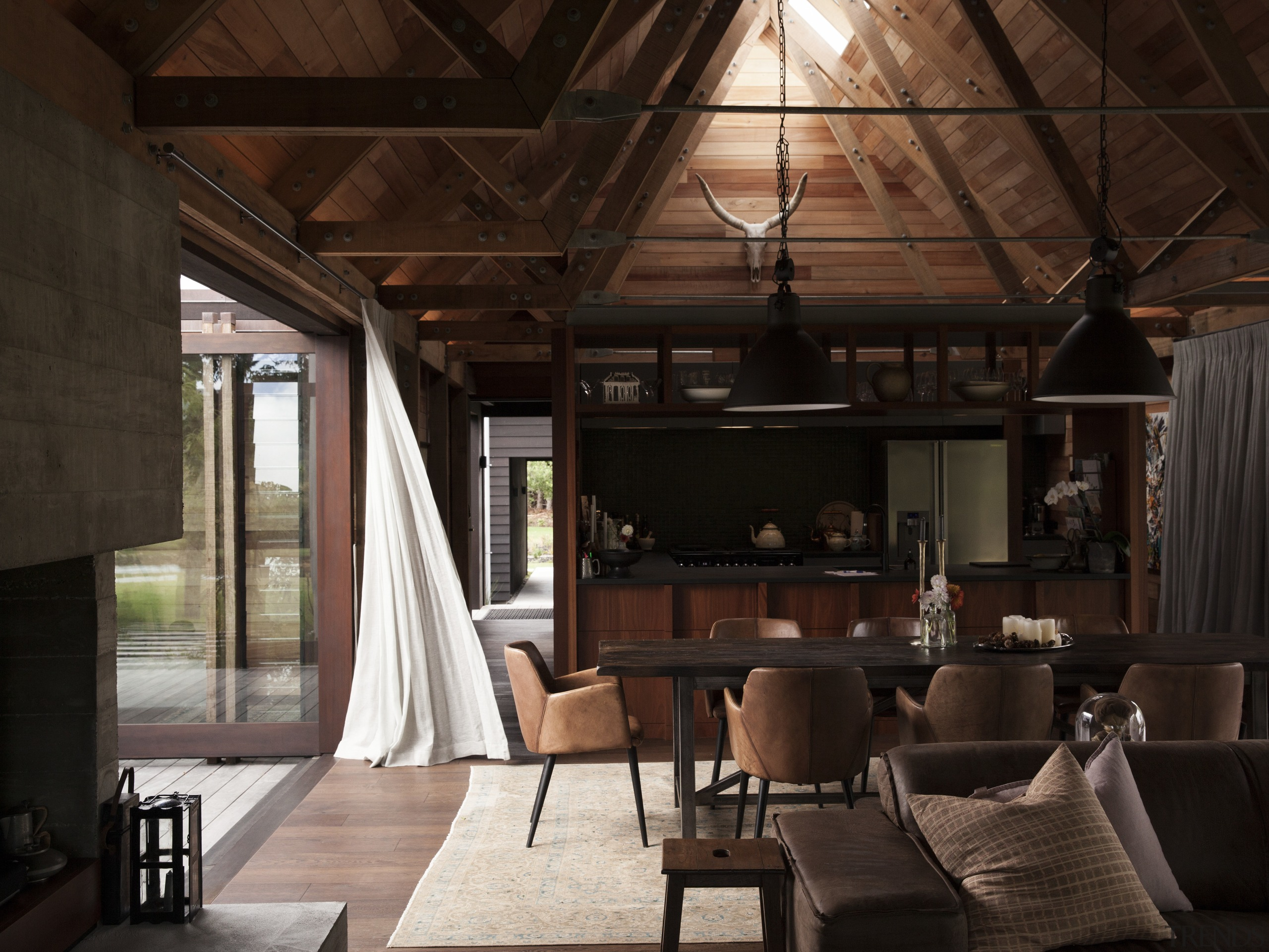 On this award-winning home, the cathedral-like interior has ceiling, interior design, living room, wood, brown, black