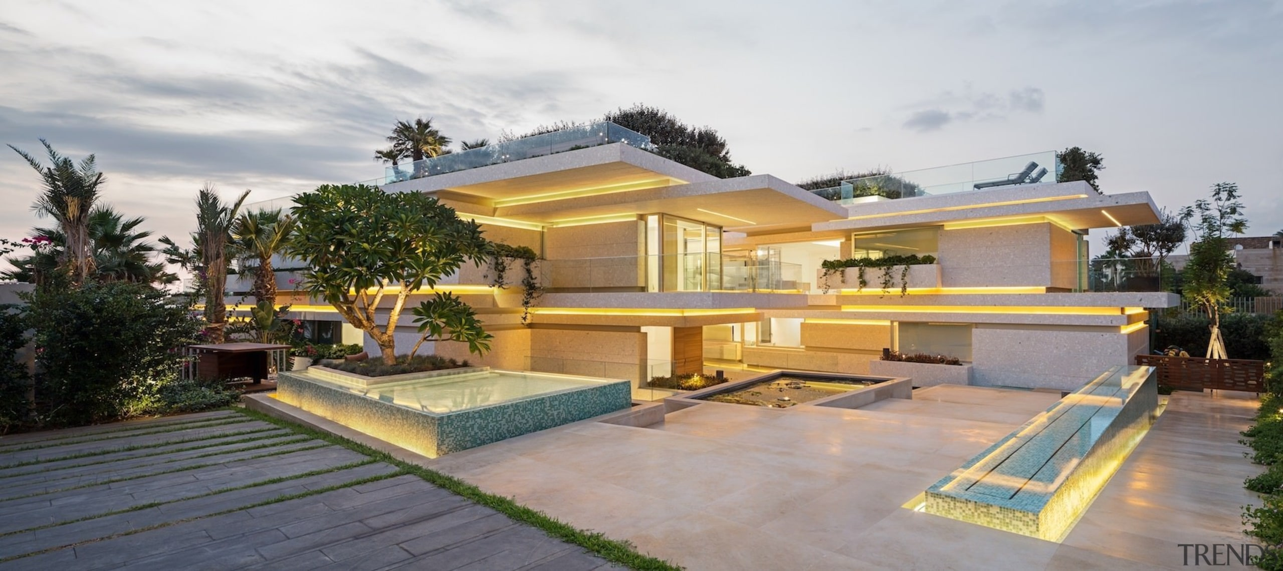 Recessed lighting is hidden during the day, but backyard, elevation, estate, facade, home, house, property, real estate, residential area, villa, gray