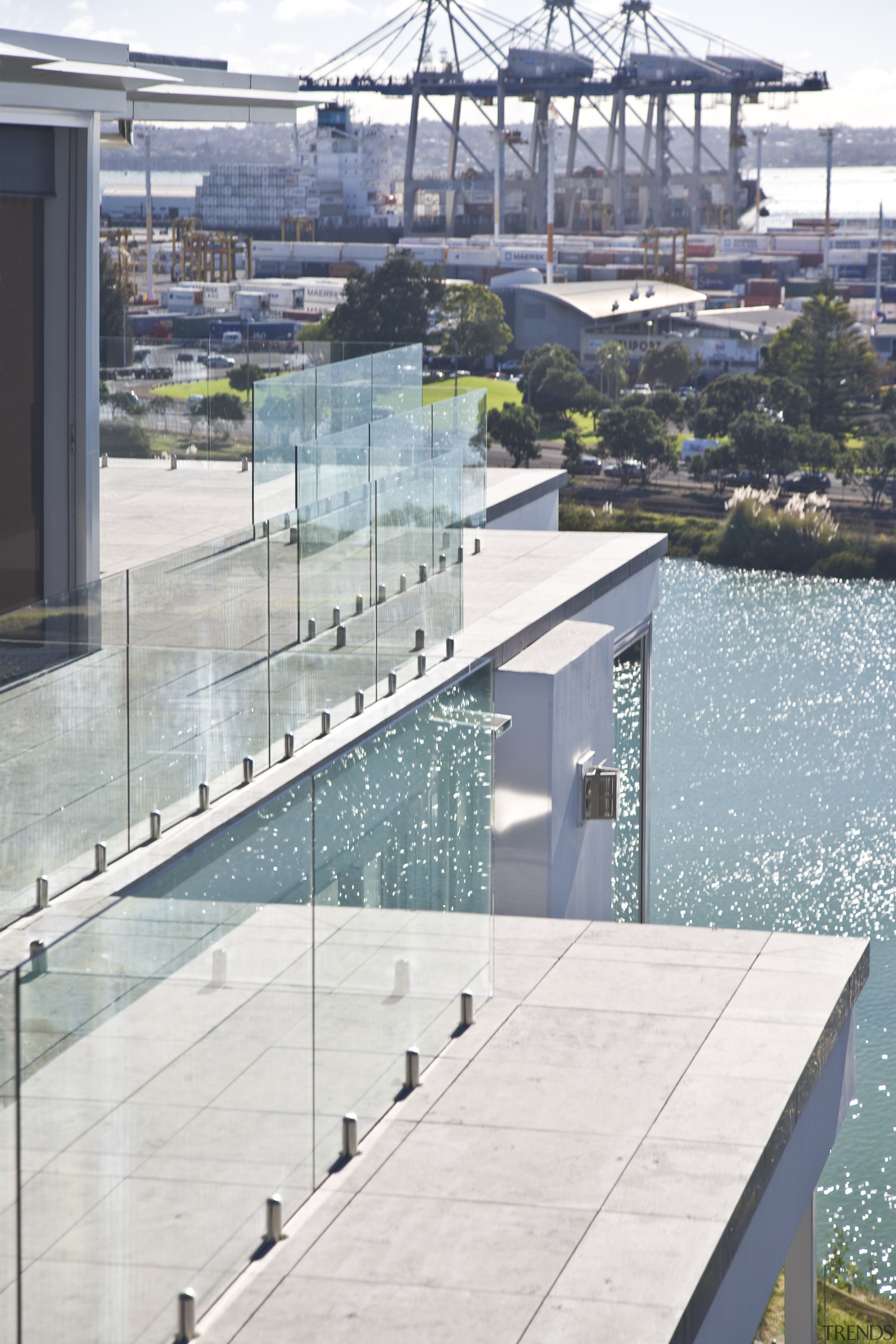 View of apartment balconies with glass balustrades. condominium, swimming pool, water, gray, white