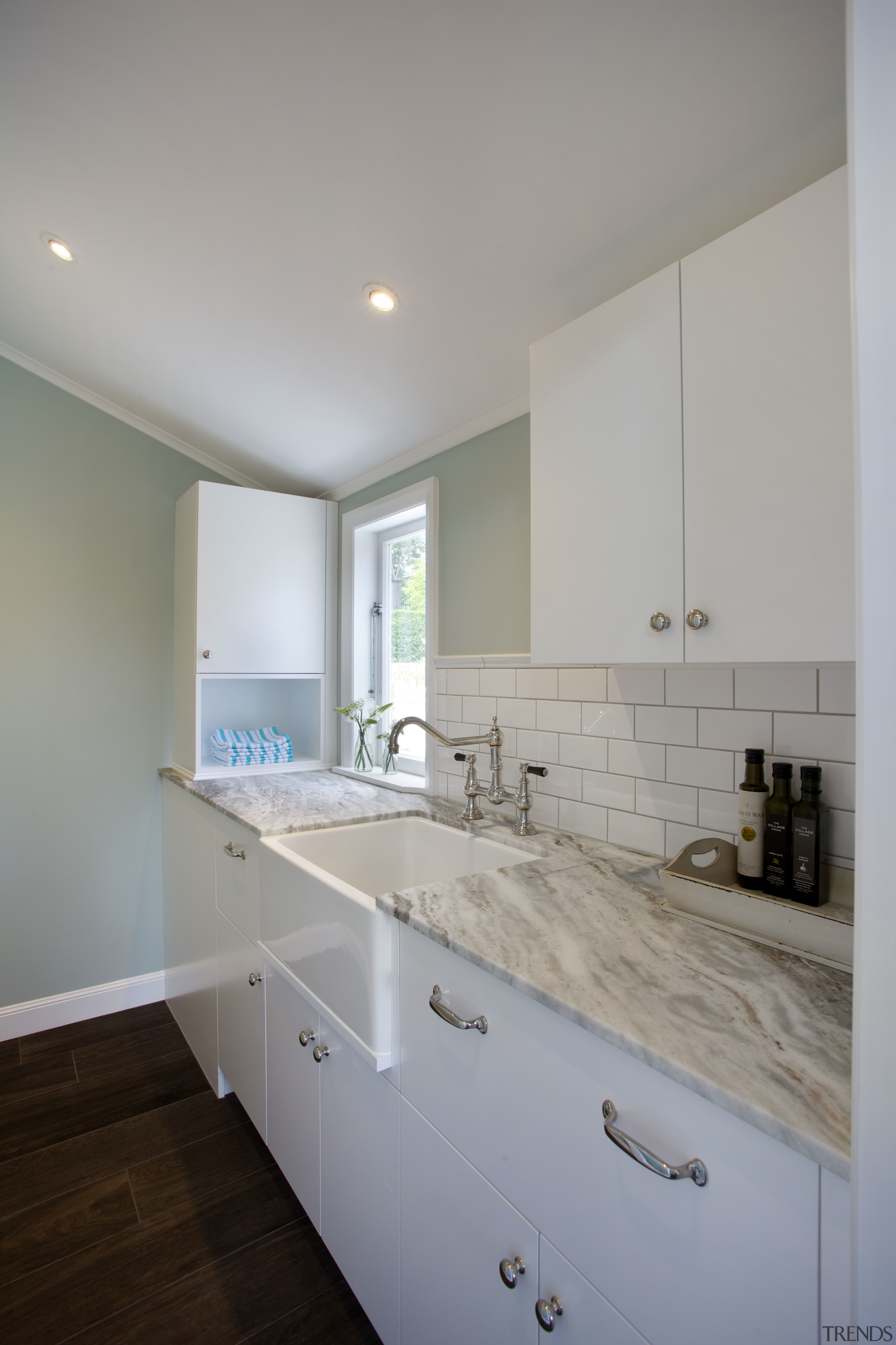 In this design, the butlers sinks are set architecture, bathroom, countertop, daylighting, floor, home, house, interior design, kitchen, real estate, room, sink, gray