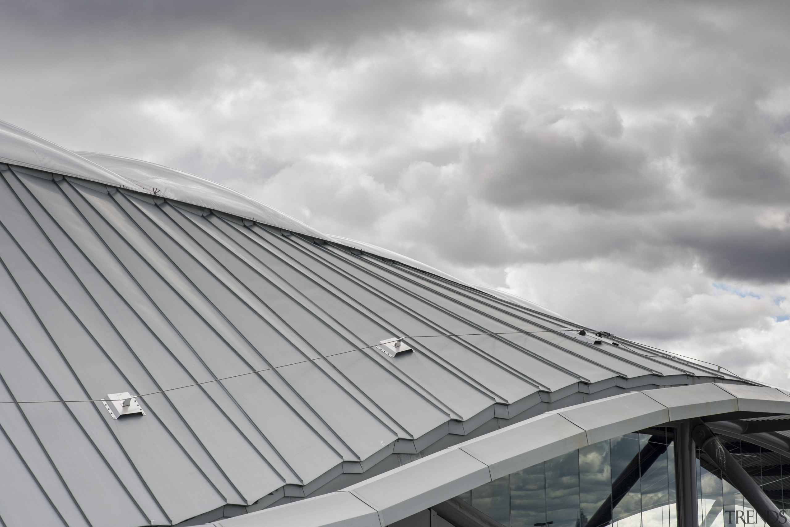 The roof was chosen in part for its architecture, building, cloud, daylighting, daytime, facade, line, roof, sky, structure, gray