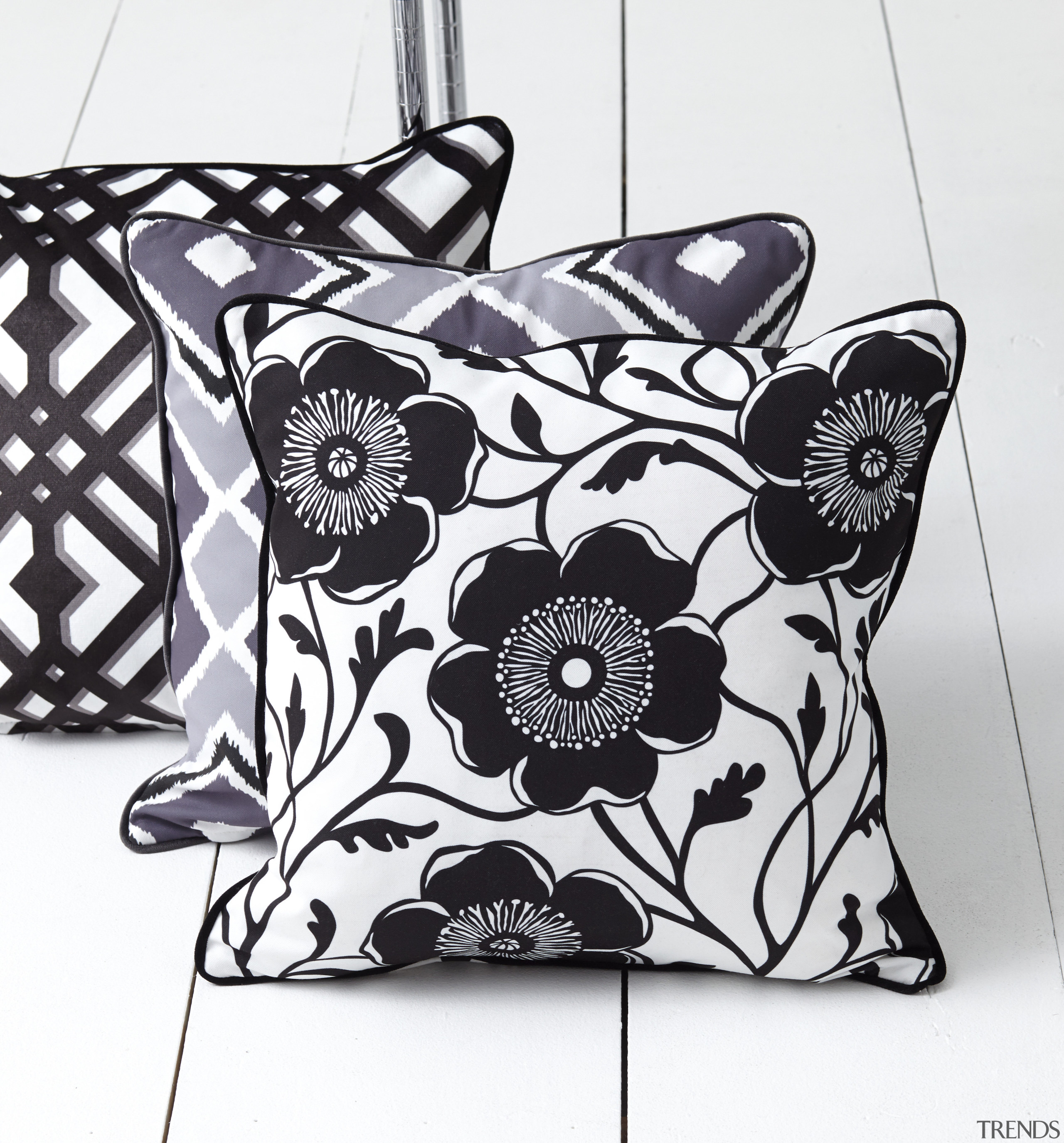 In modern commercial interiors, an eye-catching furnishing scheme black and white, cushion, design, font, monochrome, monochrome photography, pattern, product, throw pillow, white