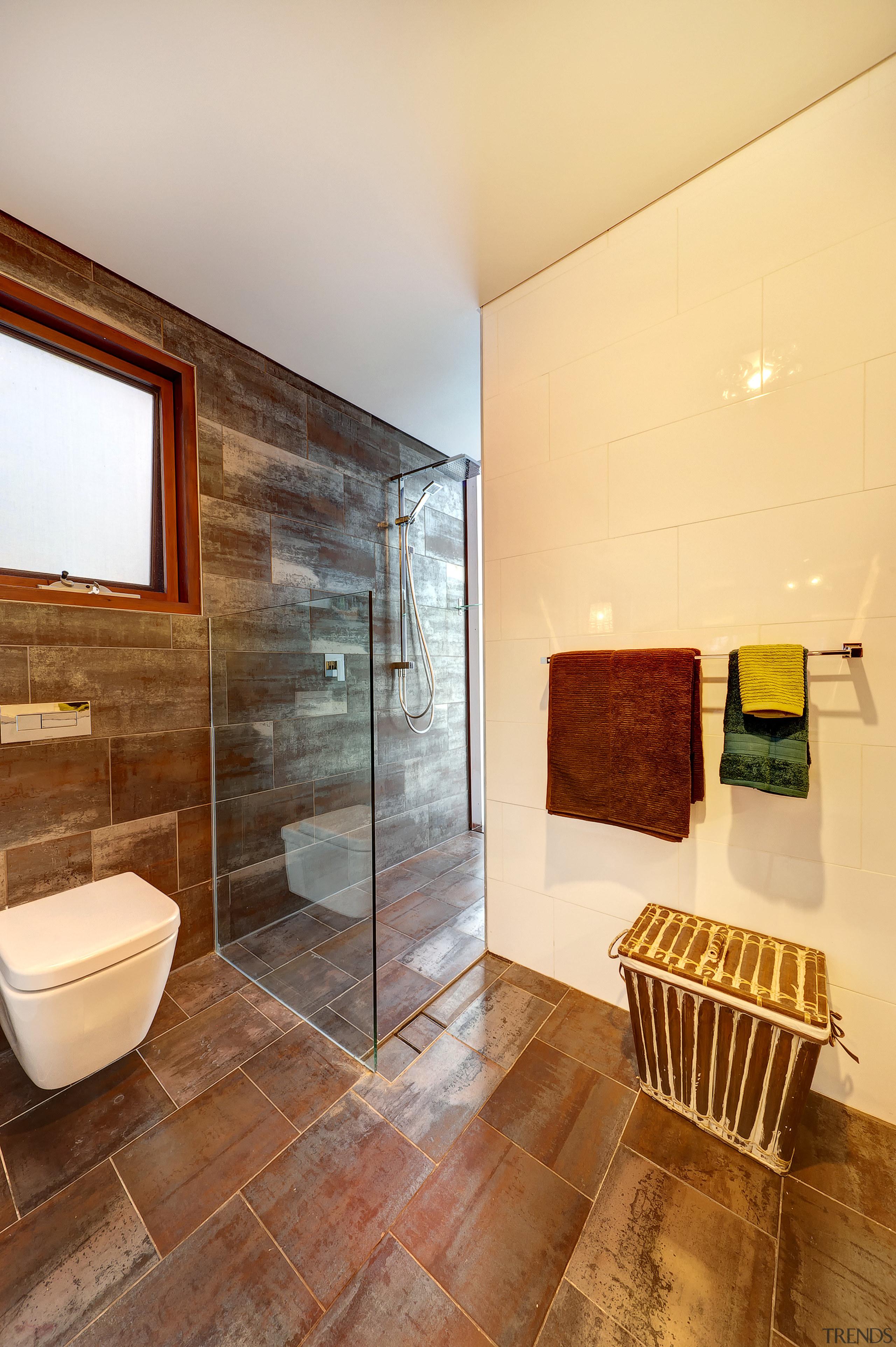 Tiles with a rusty metallic look line this architecture, bathroom, ceiling, estate, floor, flooring, home, house, interior design, real estate, room, tile, wood flooring, orange, brown