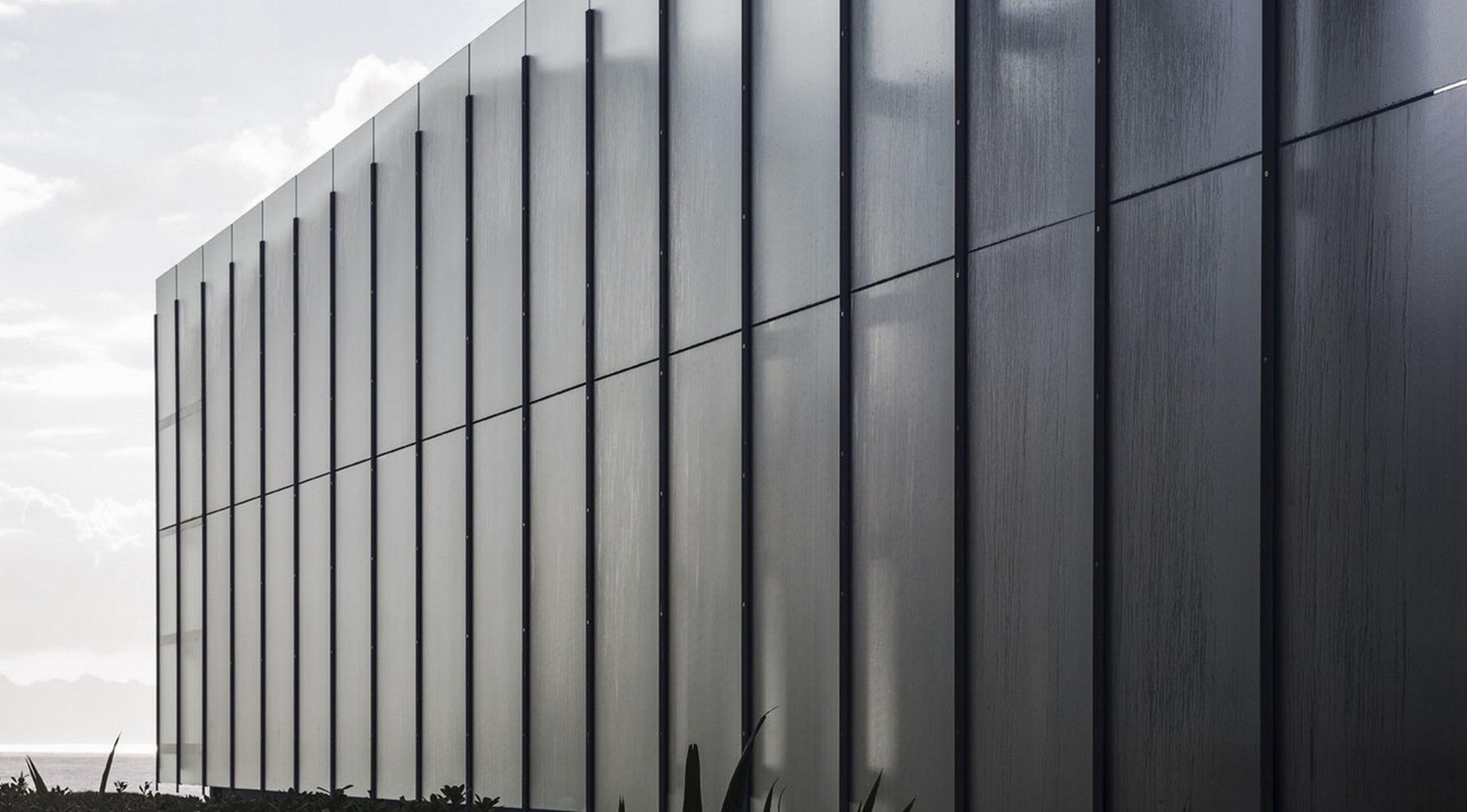 Winner of the Villa Category at the World architecture, black and white, building, corporate headquarters, daylighting, facade, headquarters, line, sky, structure, wall, gray, black