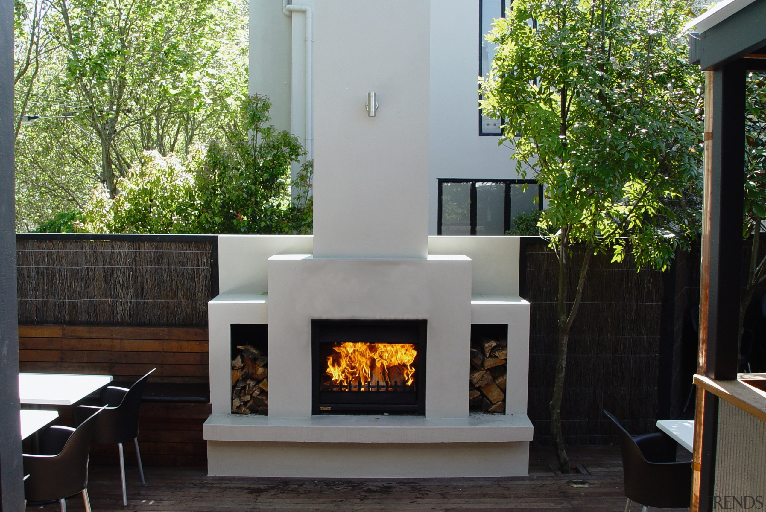 view of this outdoor wood fireplace with wood fireplace, hearth, wood burning stove, black, gray