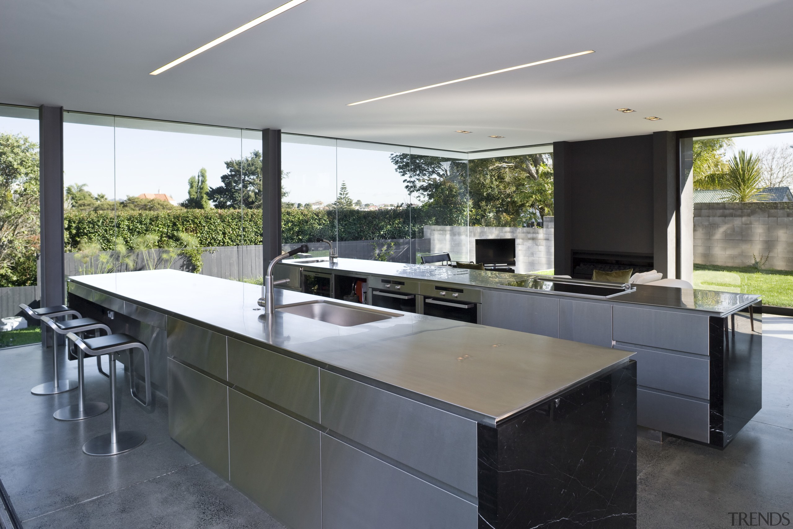 View of open-plan kitchen featuring polished concrete flooring, architecture, countertop, house, interior design, kitchen, real estate, gray, black