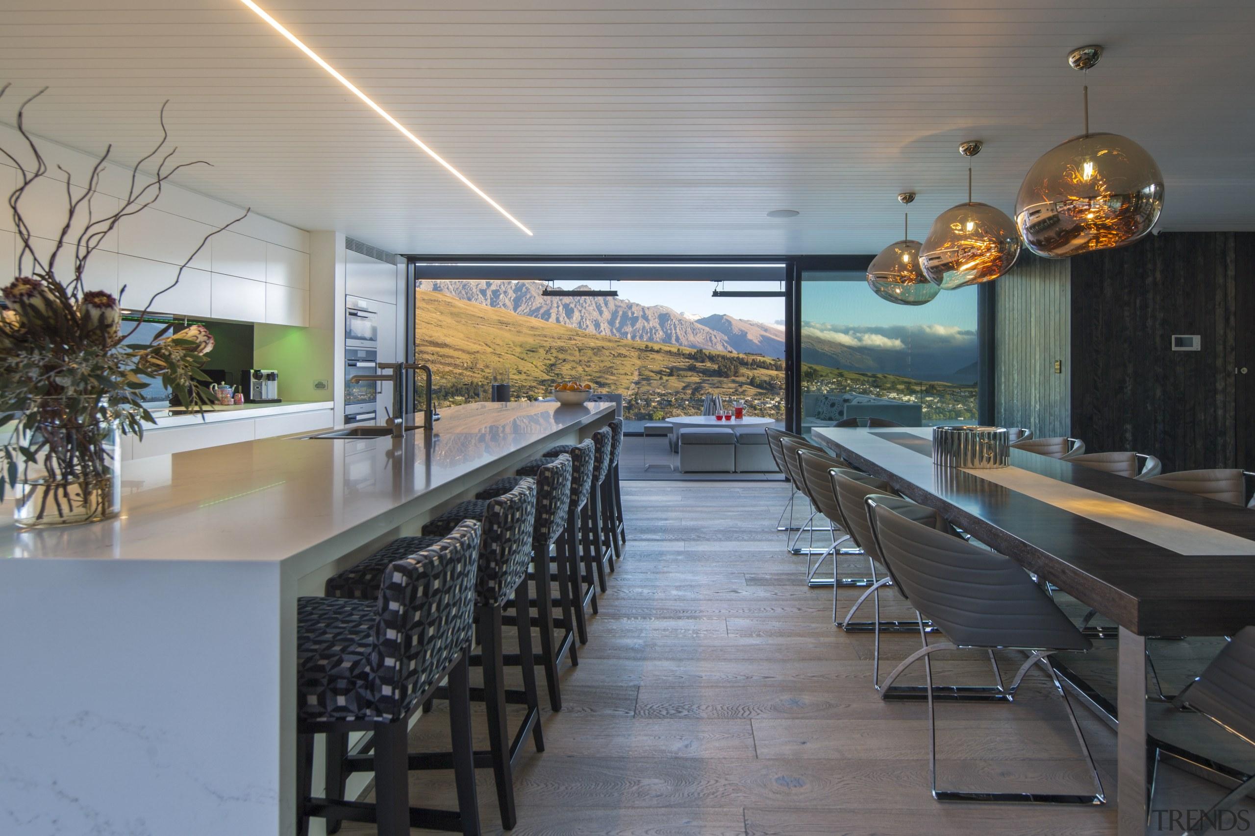 The long white, minimalist kitchen in this mountain gray, black