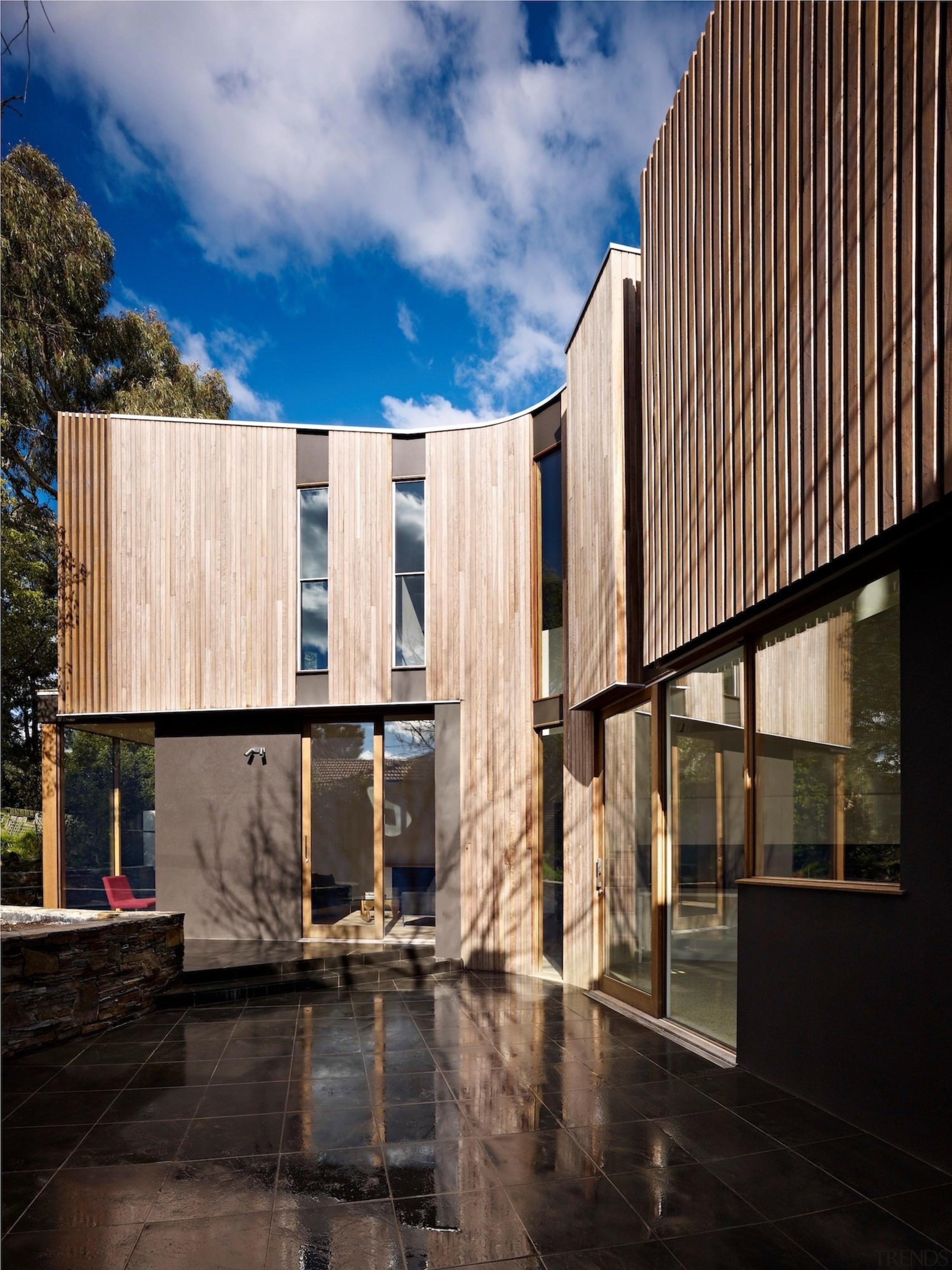 Architect: Steffen Welsch ArchitectsPhotography: Rhiannon Slatter apartment, architecture, building, condominium, facade, home, house, real estate, reflection, residential area, sky, wood, black