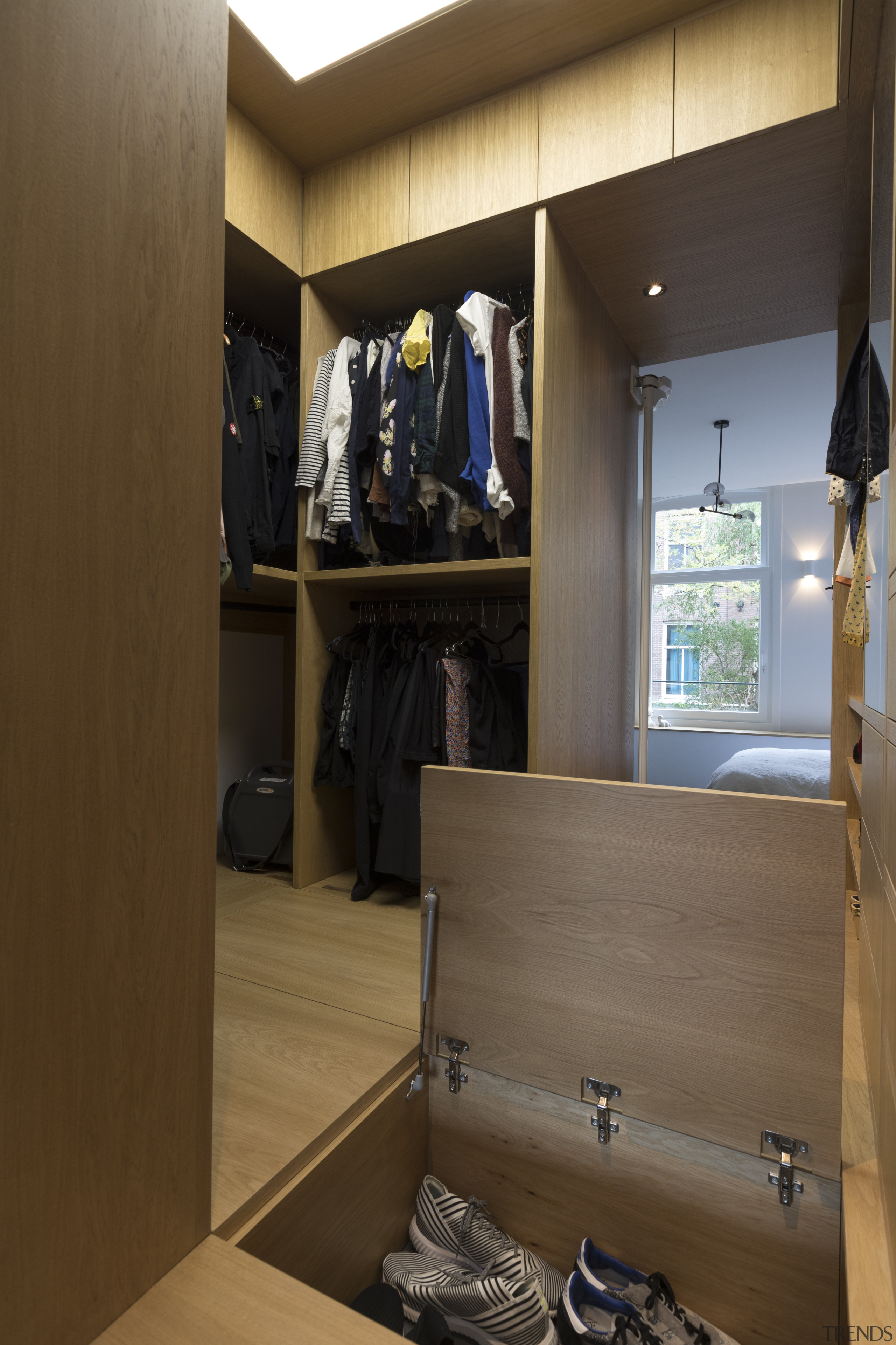 ​​​​​​​With additional compartments inside the raised floor, this architecture, building, cabinetry, closet, cupboard, floor, furniture, interior design, shelf, shelving, wardrobe, Cantero