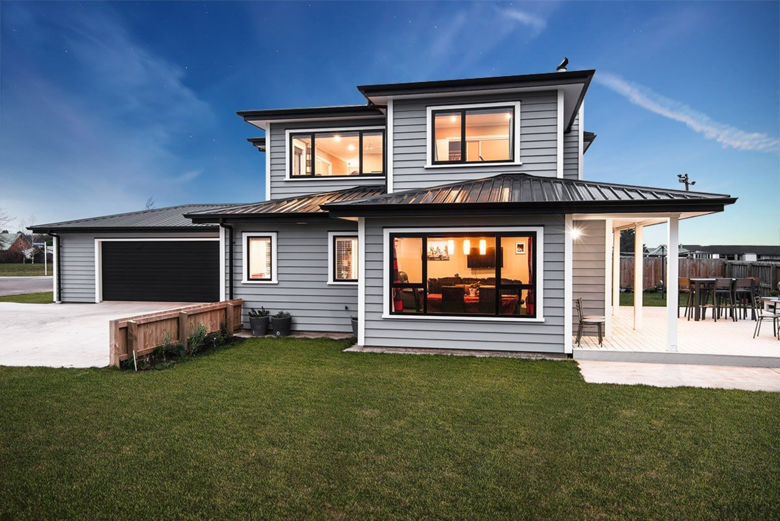 A new home clad with Envira Weatherboard System cottage, elevation, estate, facade, home, house, luxury vehicle, property, real estate, residential area, siding, window, brown, blue